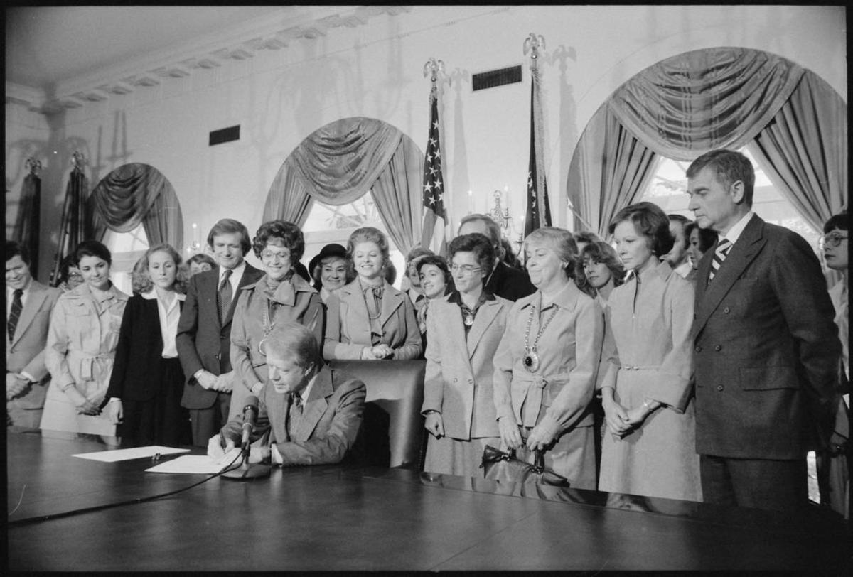 President Jimmy Carter signing an extension to the Equal Rights Amendment.