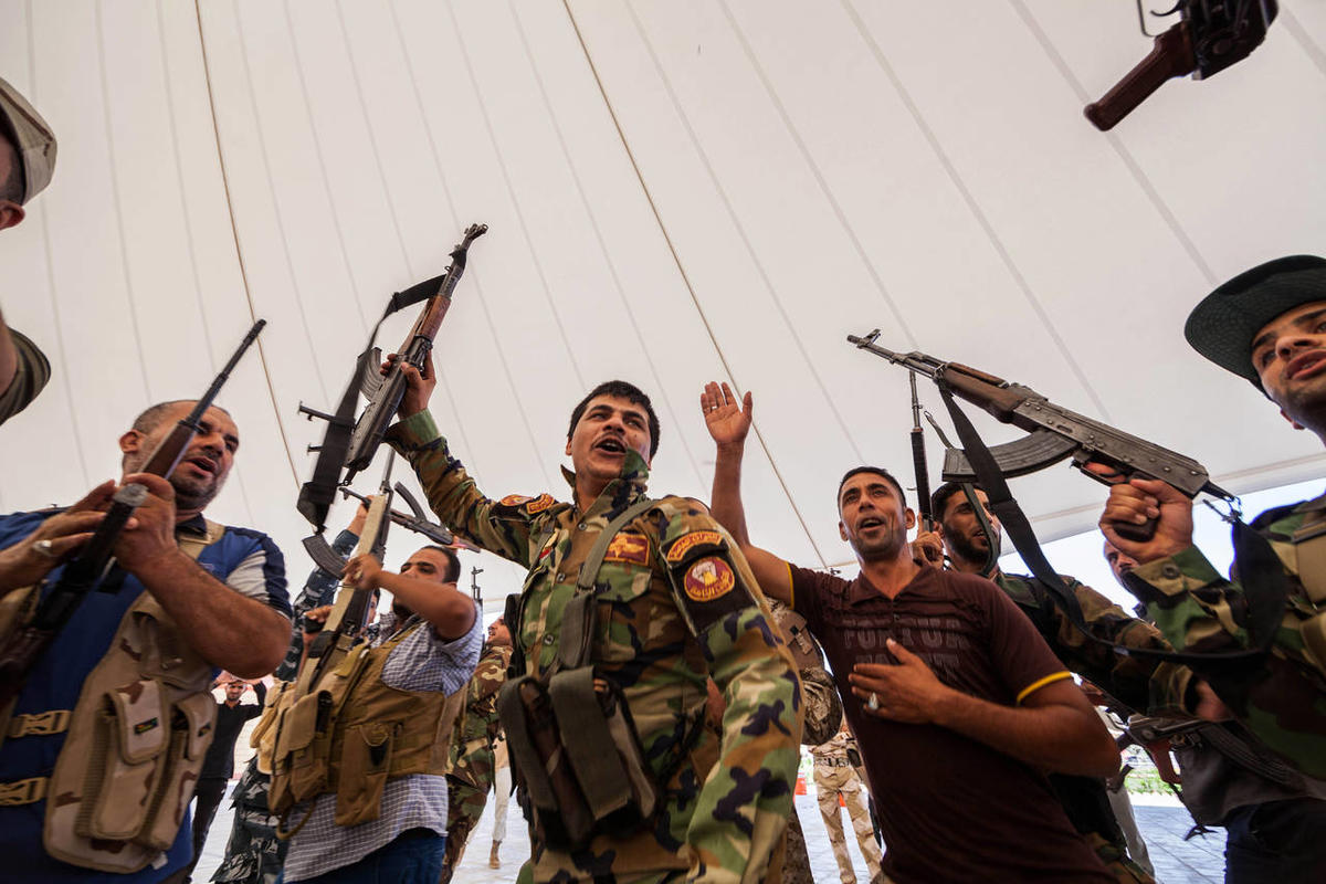 An Iraqi volunteer force chant slogans against the al-Qaida-inspired Islamic State of Iraq and the Levant during training in the Shiite holy city of Karbala, 50 miles south of Baghdad, Iraq, Wednesday, June 25, 2014, after authorities urged Iraqis to help