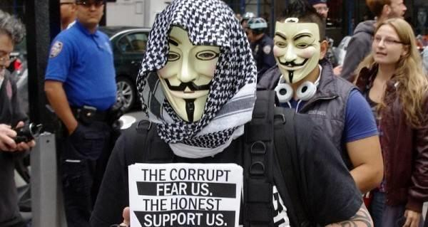 Members of the online group Anonymous protest at an Occupy Wall Street event.