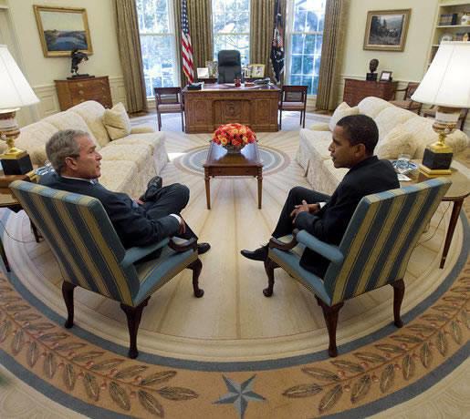 President Barack Obama and former president George W. Bush talk in the White House.