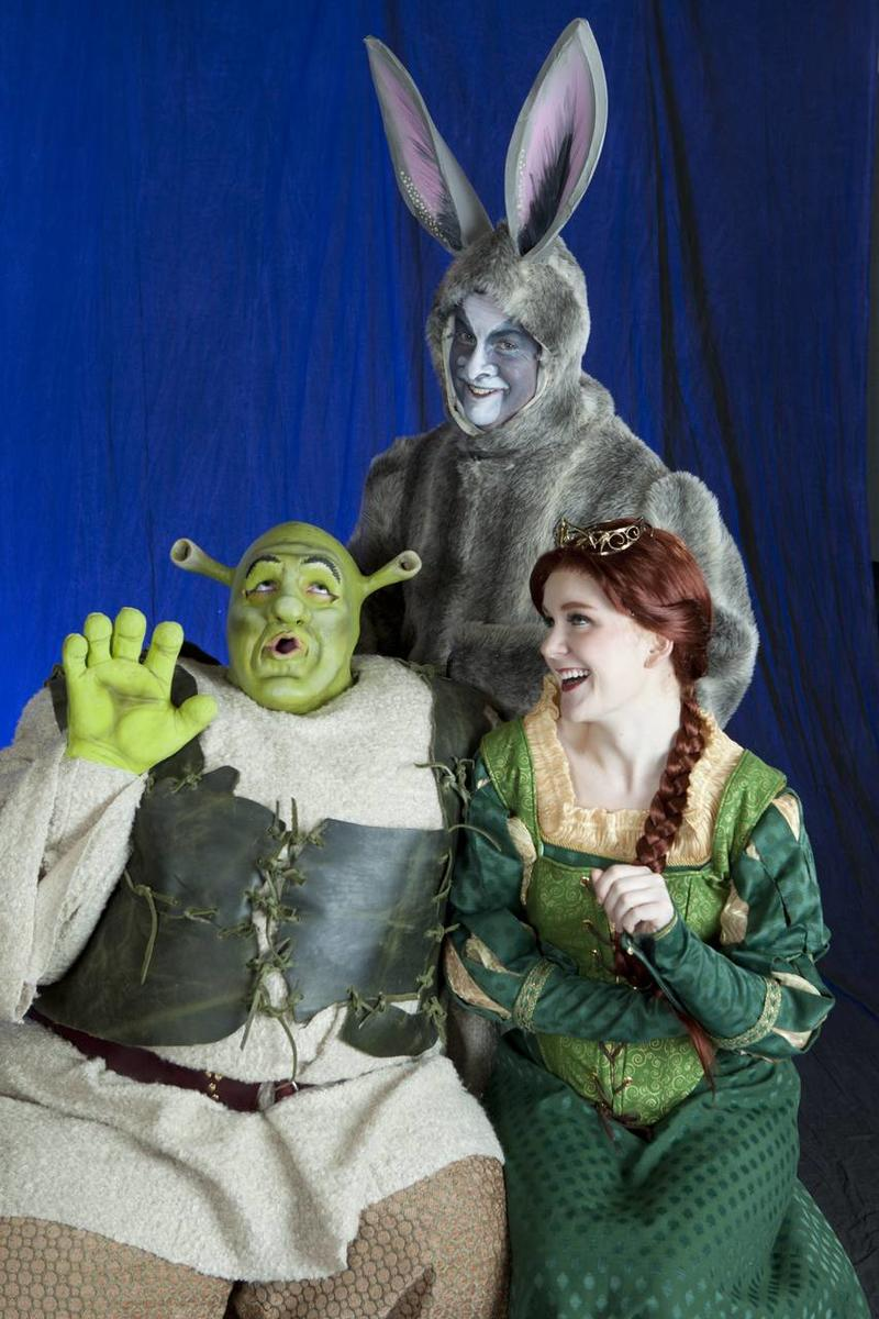 "Cameron Kapetanov, left, as Shrek, Douglas Caldwell as Donkey and Katie Frandsen as Fiona in CenterPoint Legacy Theatre's production of ""Shrek the Musical."""
