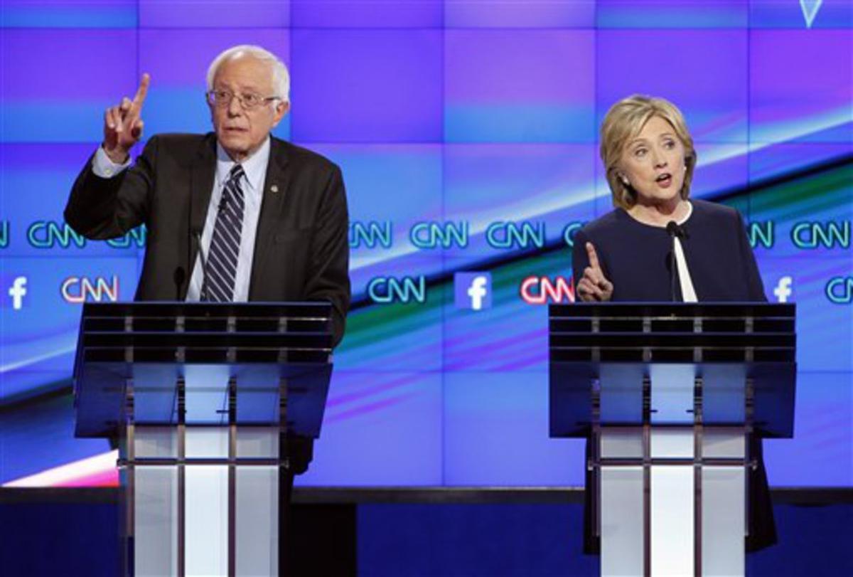 Hillary Rodham Clinton, right, and Sen. Bernie Sanders, of Vermont, speak during the CNN Democratic presidential debate Tuesday, Oct. 13, 2015, in Las Vegas. (AP Photo/John Locher)