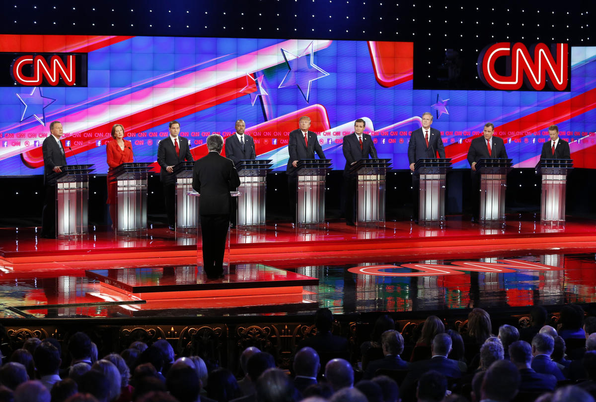 Republican presidential candidates, from left, John Kasich, Carly Fiorina, Marco Rubio, Ben Carson, Donald Trump, Ted Cruz, Jeb Bush, Chris Christie, and Rand Paul share the stage with debate moderator Wolf Blitzer during the CNN Republican presidential d