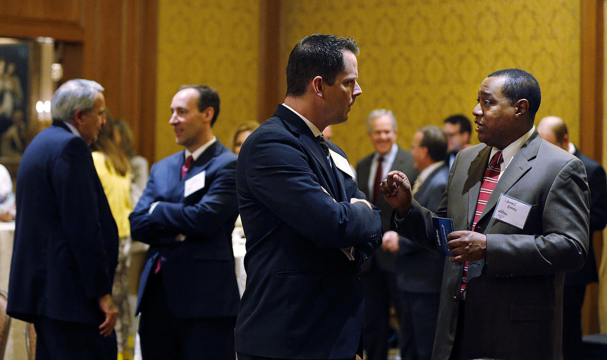 FILE — Rep. Jacob Anderegg, R-Lehi, left front, and James Evans talk before a press conference in Salt Lake City, Tuesday, May 12, 2015. After two Republican candidates for state Senate District 13 suspended their campaigns Tuesday, it appeared Anderegg w