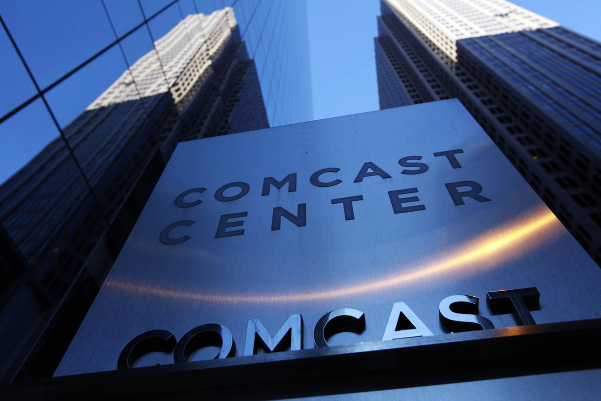 FILE - In this Dec. 3, 2009 file photo, a sign outside the Comcast Center is seen in Philadelphia. A panel of appeals court judges agreed with the Obama administration that the FCC could impose net neutrality. Criticism of the decision could prod Congress