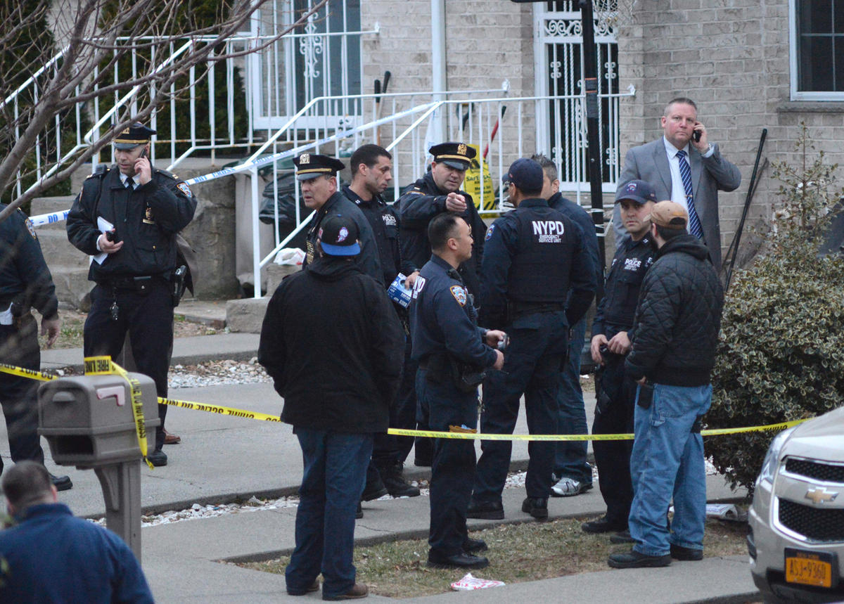 In this March 28, 2014, file photo, New York City Police gather at the scene as they investigate a triple shooting in the Rosebank section of the Staten Island borough of New York. During an 18-year period in which national incarceration rates climbed by