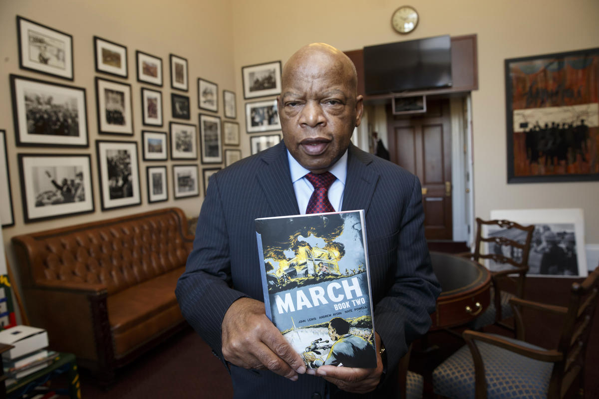 """Rep. John Lewis, D-Ga., holds an installment of his award-winning graphic novel """"March"""" on Jan. 15, 2015. The New York Times recently announced a move to eliminate its Graphic Bestseller list, a decision vexing many authors like Lewis who believe in the i"""