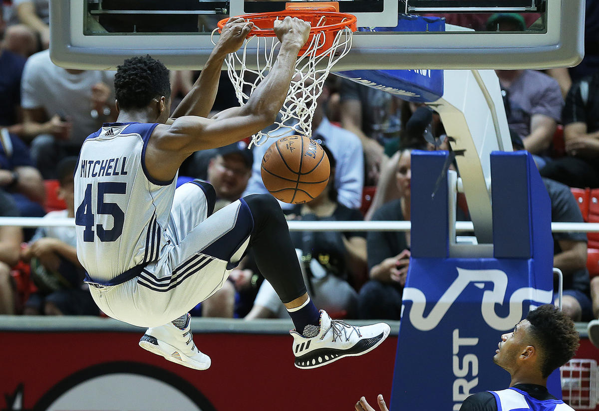 Utah Jazz guard Donovan Mitchell (45) goes high for a dunk as the Utah Jazz and the Philadelphia 76ers play in Summer league action in the Huntsman Center at the University of Utah in Salt Lake City on Wednesday, July 5, 2017.