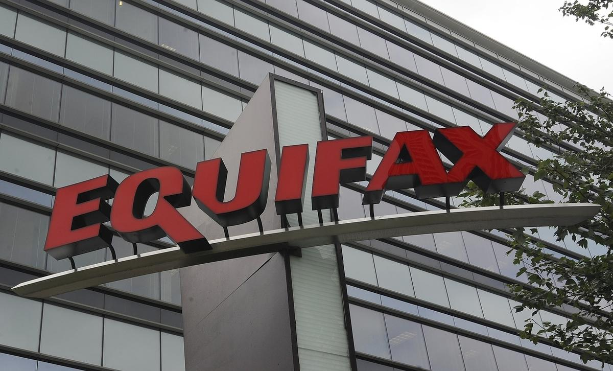 This Saturday, July 21, 2012, photo shows signage at the corporate headquarters of Equifax Inc. in Atlanta. A Wall Street Journal report says that hackers broke into Equifax's computer systems in March 2017, giving them time to probe vulnerabilities and e