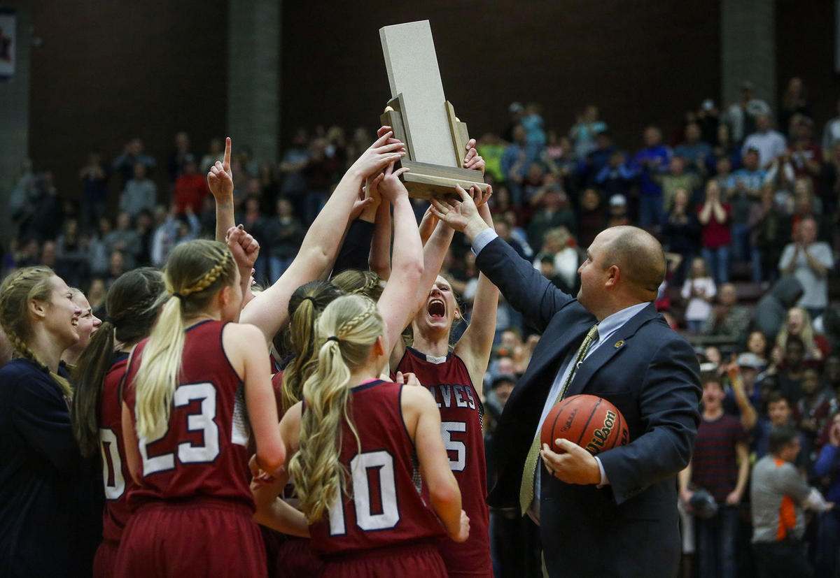 FILE: Members of the North Sevier High School Wolves girl's basketball team react to their win against the Emery High School Spartans in the final round of the Girls High School 2A Championships at Snow College in Richfield on Saturday, Feb. 25, 2017. The