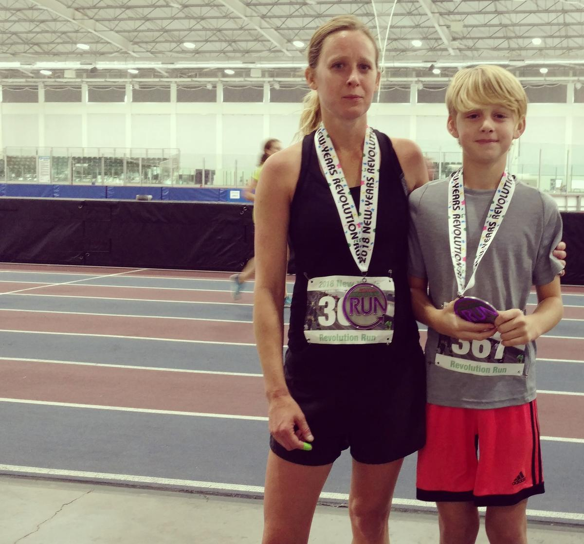 Arianne Brown stands with her son Ace after running the New Year's Revolution Run together.