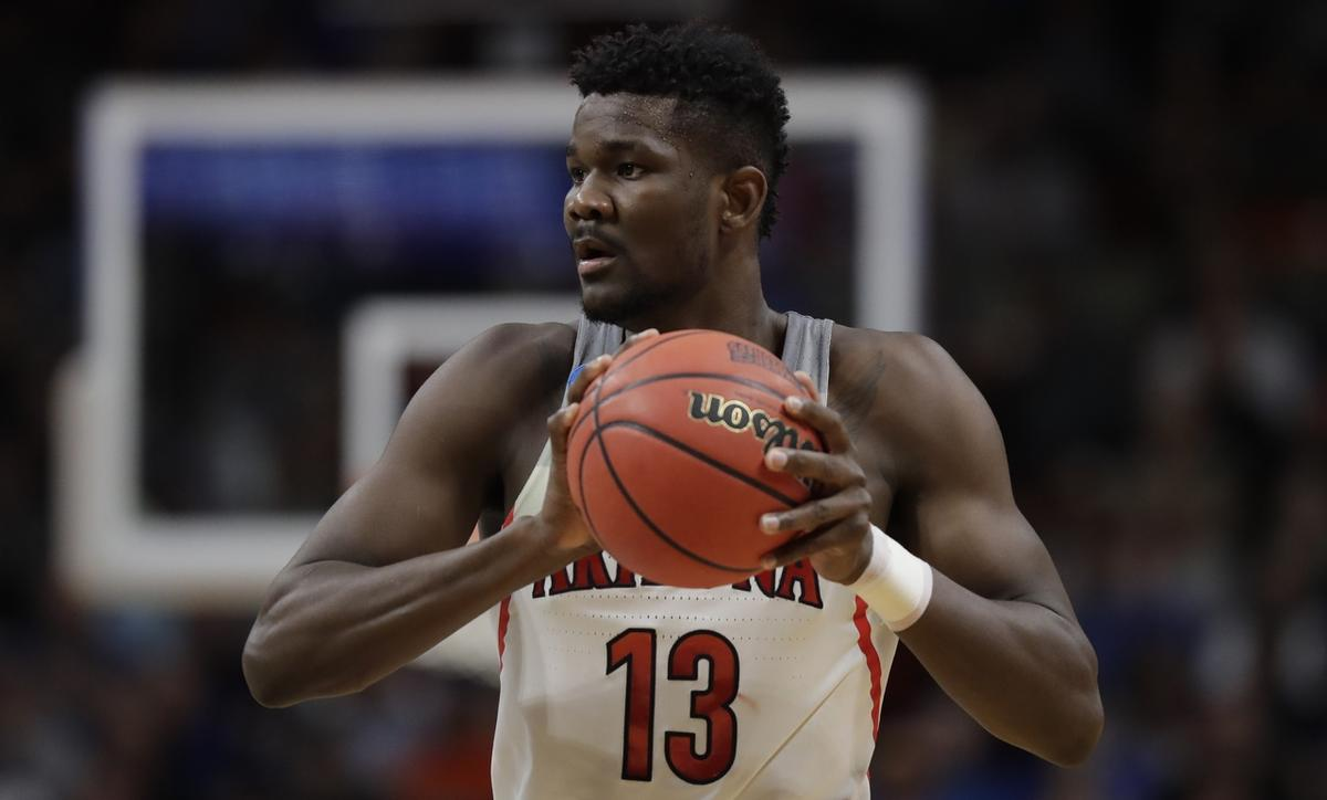 Arizona forward Deandre Ayton holds the ball against Buffalo during the first half of a first-round game in the NCAA men's college basketball tournament Thursday, March 15, 2018, in Boise, Idaho. (AP Photo/Ted S. Warren)