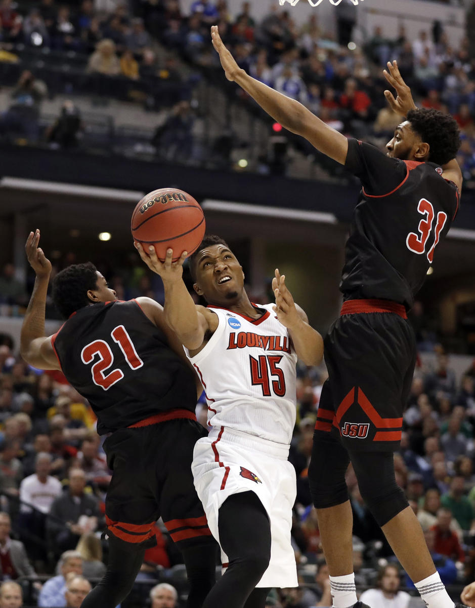 Louisville's Donovan Mitchell (45) heads to the basket as Jacksonville State's Malcolm Drumwright (21) and Christian Cunningham (31) defendduring the first half of a first-round game in the men's NCAA college basketball tournament Friday, March 17, 2017,