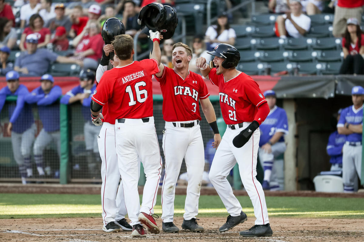 Utah's Chandler Anderson is greeted at home after hitting a grand slam in the third inning during the Utes' victory over BYU at Smith's Ballpark in Salt Lake City on Tuesday, May 8, 2018.