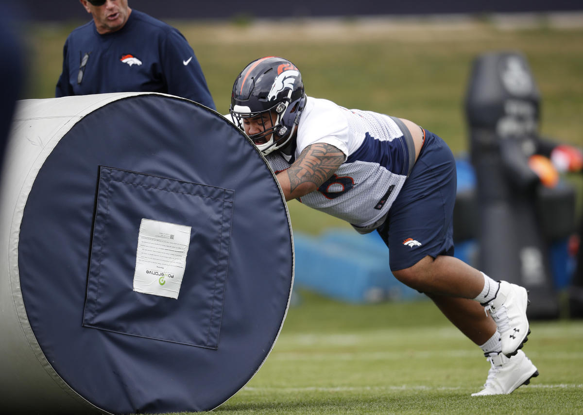 Denver Broncos rookie nose tackle Lowell Lotulelei takes part in drills during an orientation session for the team's rookies Saturday, May 12, 2018, at the Broncos' headquarters in Englewood, Colo. Lotulelei was waived by the team Monday, May, 14, 2018.