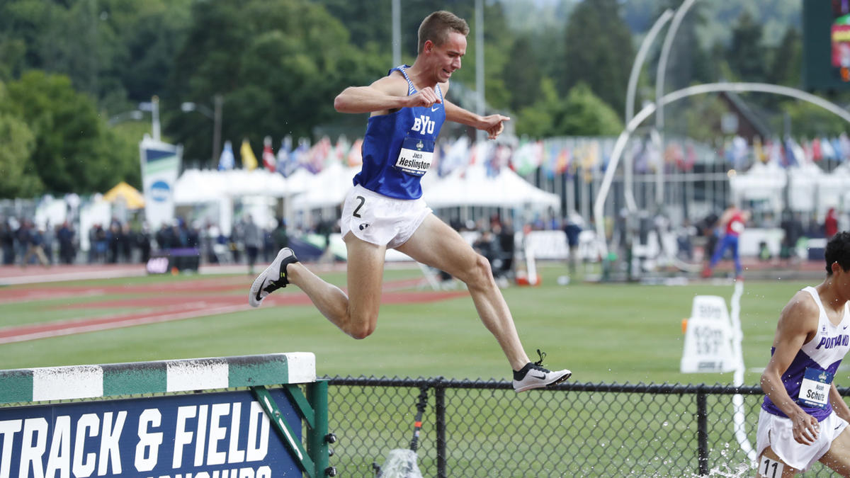 Jacob Heslington hurdles the water jump during the 3,000m steeplechase at the 2017 NCAA Outdoor Track and Field Championships.