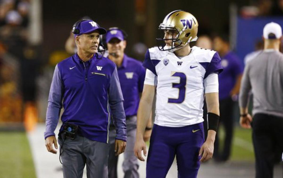 Washington coach Chris Peterson, left, talks with quarterback Jake Browning (3) during the first half of an NCAA college football game against Arizona State on Saturday, Oct. 14, 2017, in Tempe, Ariz.