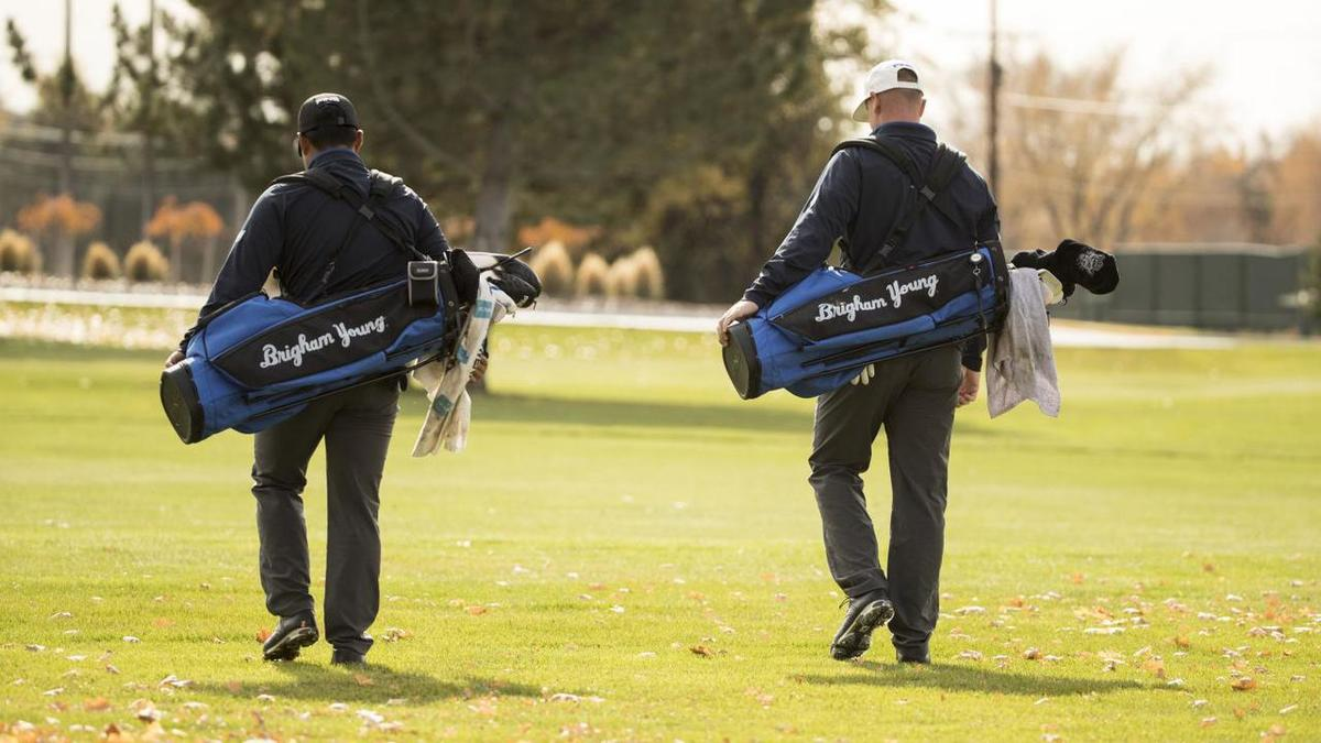 Two BYU golf players walk the course. The BYU men's golf team heads to the NCAA Championships on May 23-30.