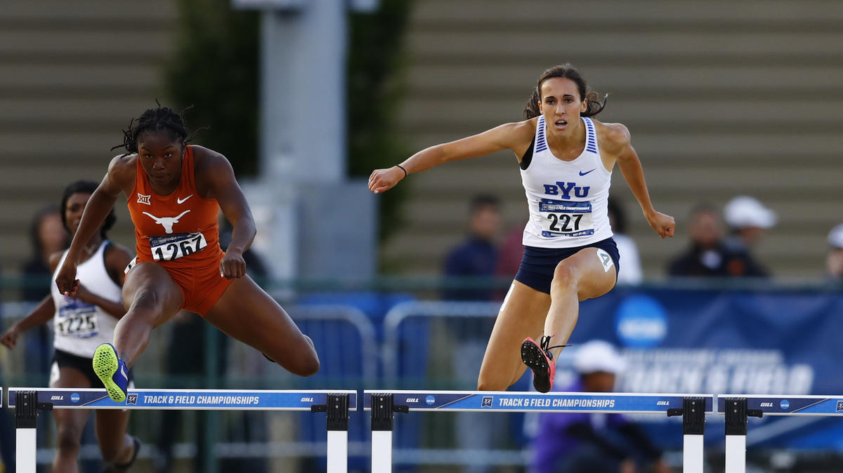 Brenna Porter (right) clears a hurdle in the 400m hurdles on her way to earning a career best (57.18) and advancing to the 2018 Track and Field Championships.