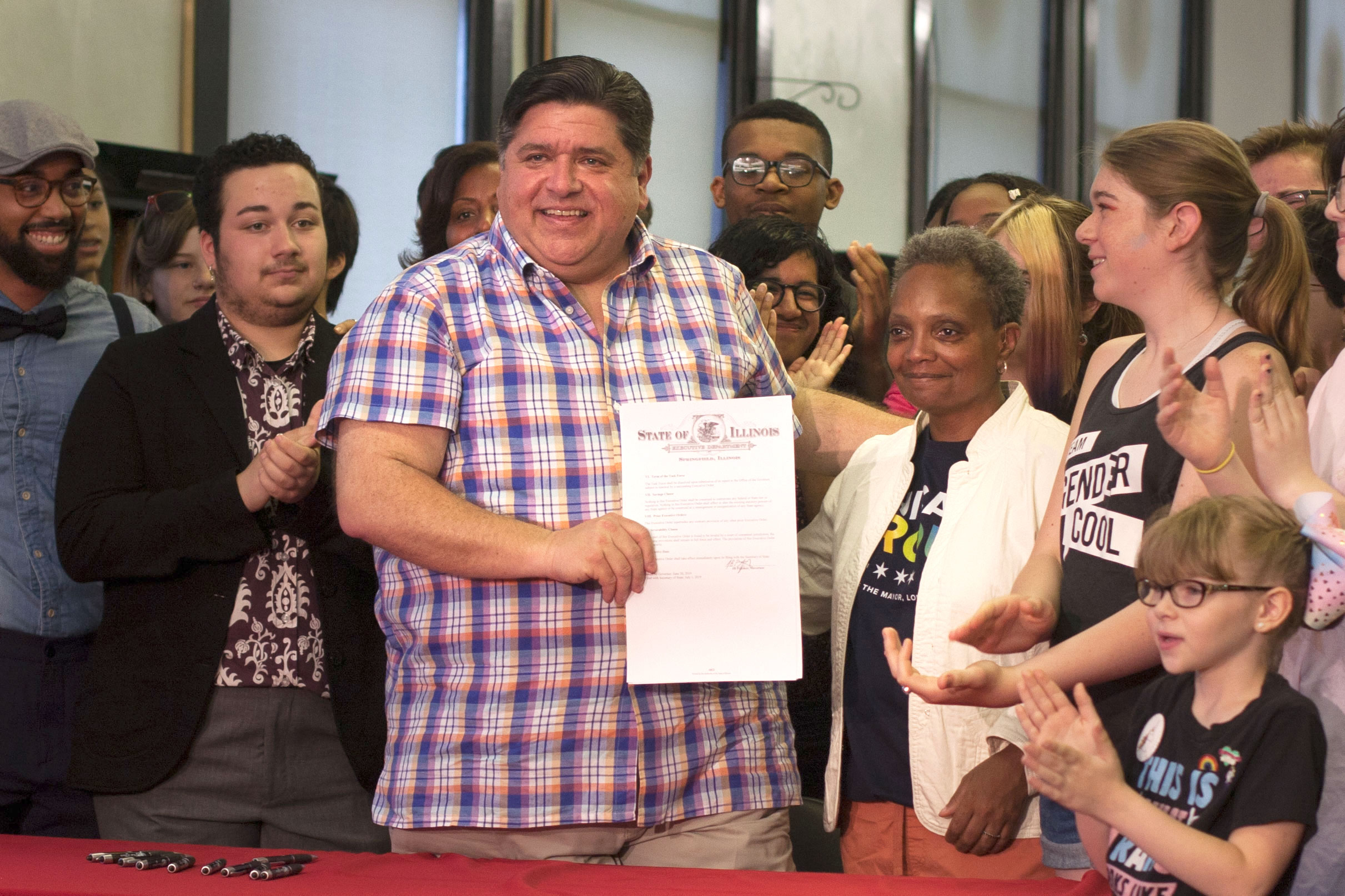 Governor J.B. Pritzker and Mayor Lori Lightfoot with executive order signed Sunday.