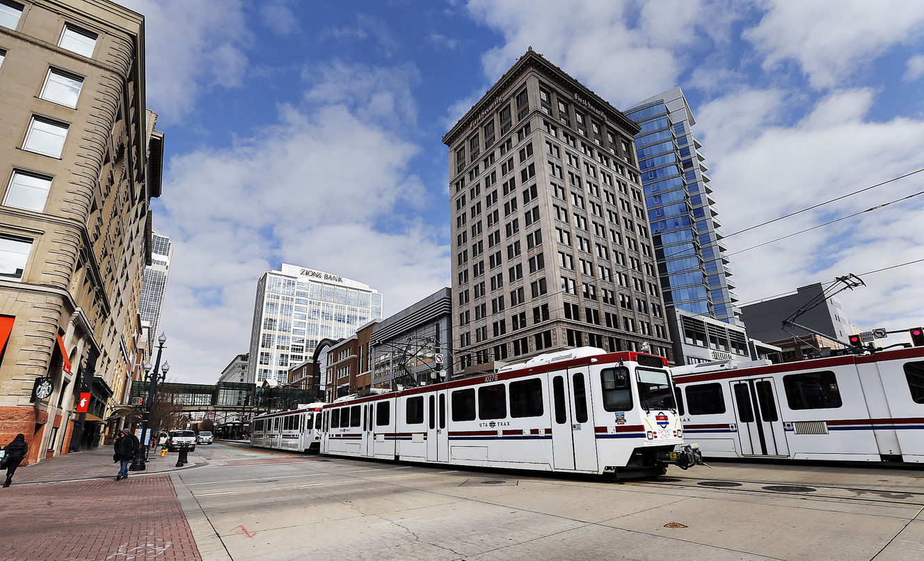 FILE - TRAX trains carry passengers through Salt Lake City on Tuesday, Jan. 23, 2018.