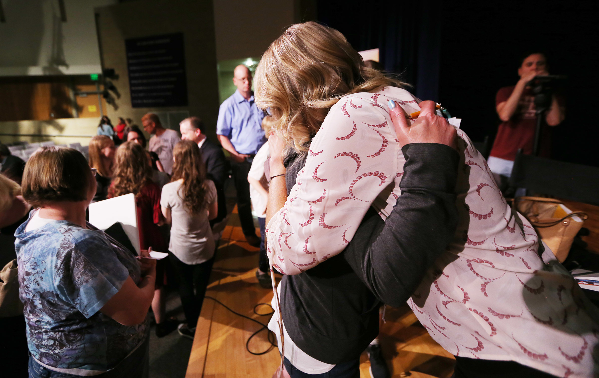 """""""Angst"""" producer Karin Gornick hugs Ginger Hales after a screening of the movie at Fort Herriman Middle School on Wednesday, May 30, 2018."""