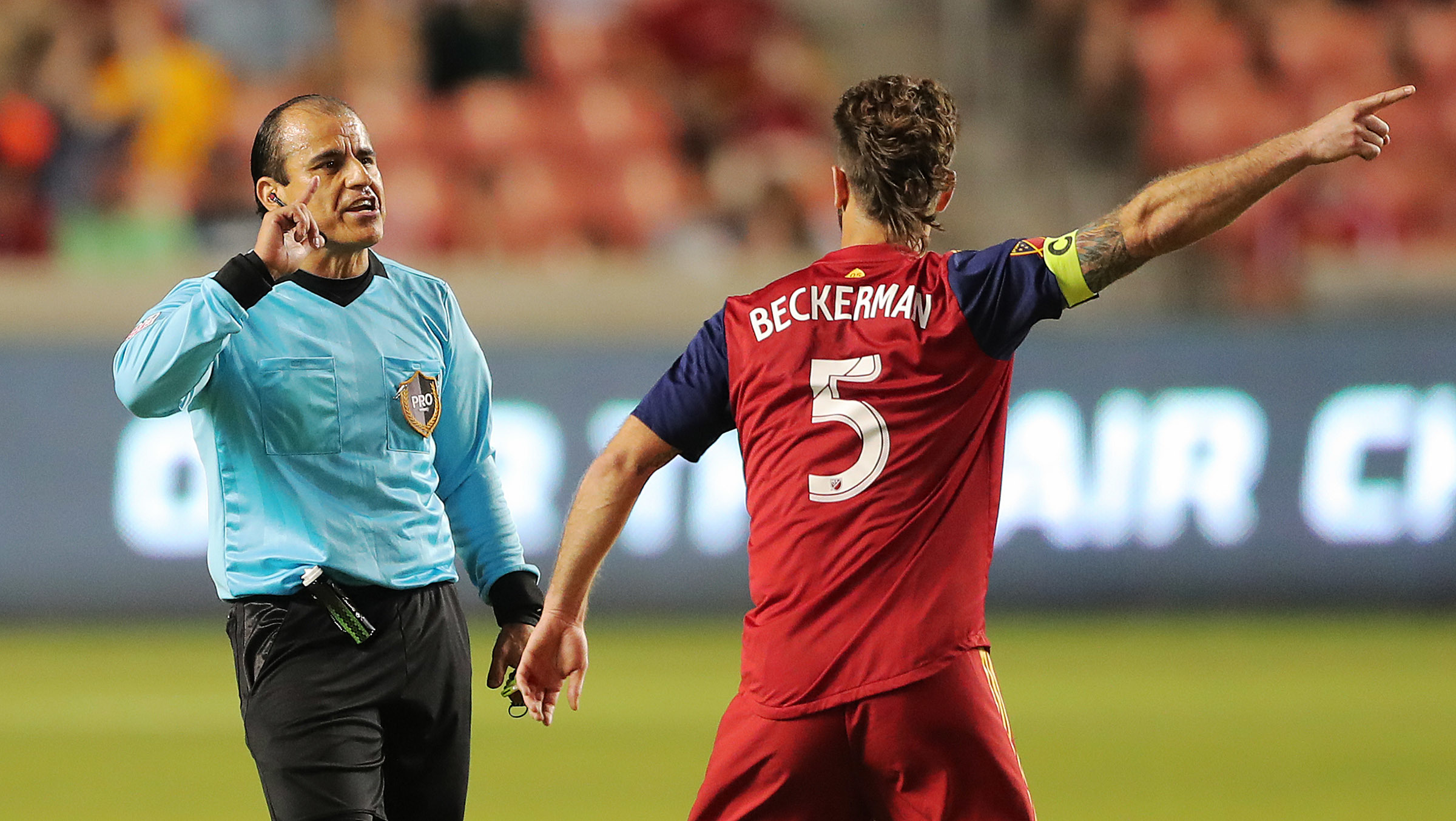Real Salt Lake midfielder Kyle Beckerman (5) argues with Referee Baldomero Toledo as Real Salt Lake and the Colorado Rapids play at Rio Tinto Stadium in Sandy on Saturday, July 21, 2018.