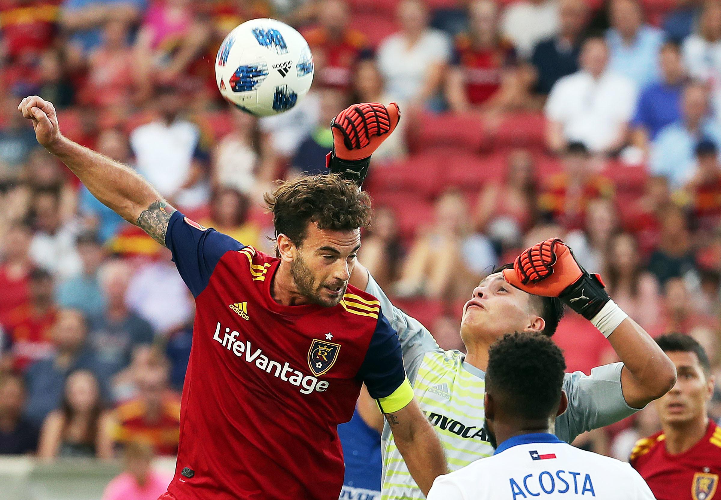 Real Salt Lake midfielder Kyle Beckerman (5) tries for a header against FC Dallas goalkeeper Jesse Gonzalez (1) during MLS soccer in Sandy on Saturday, July 7, 2018.