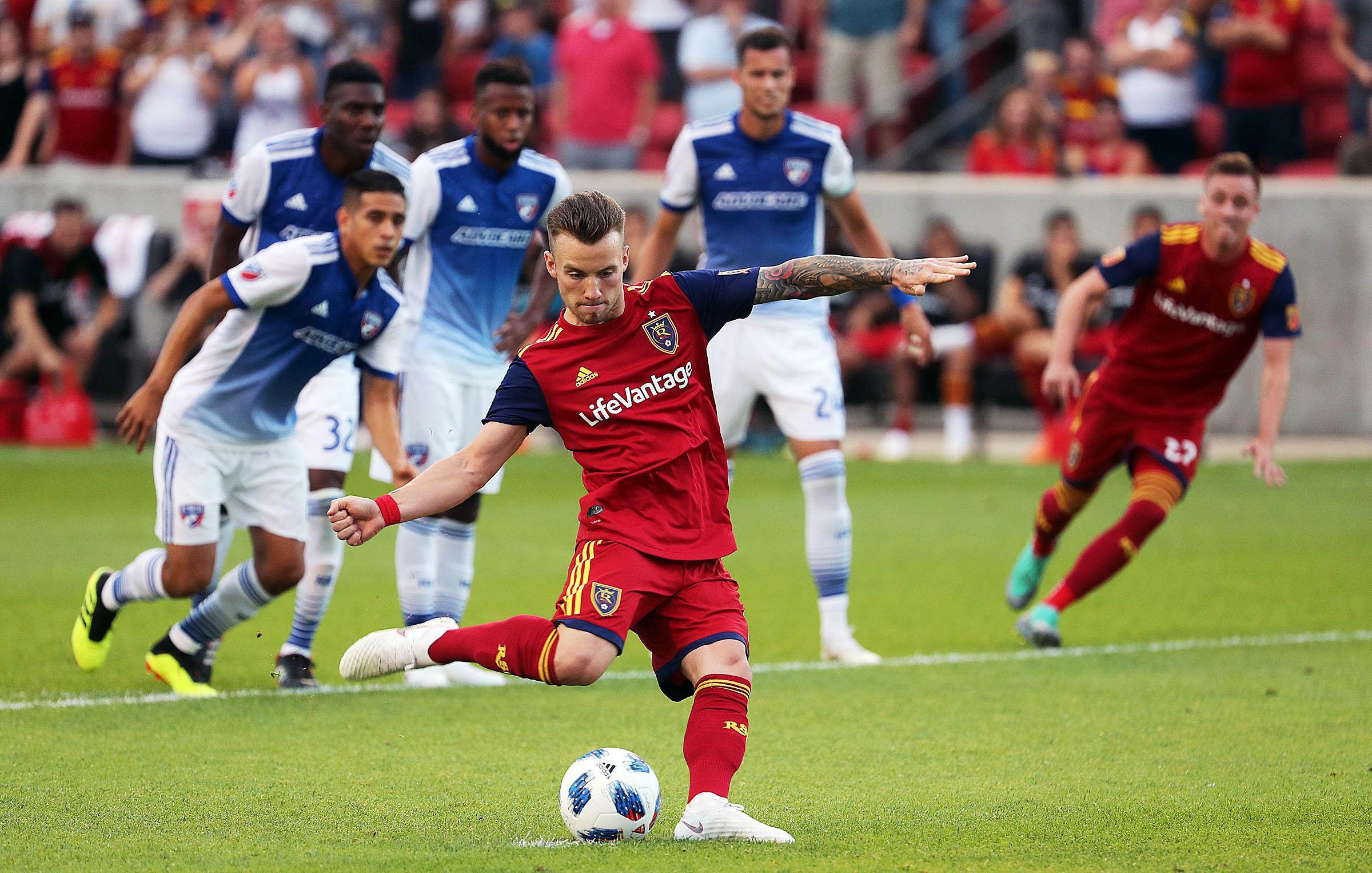 Real Salt Lake midfielder Albert Rusnak (11) scores on a penalty kick against FC Dallas during MLS soccer in Sandy on Saturday, July 7, 2018.