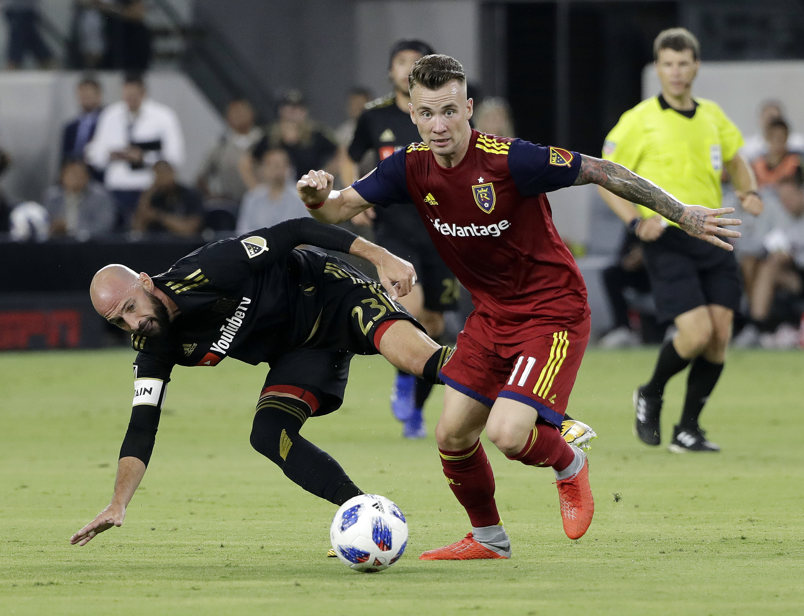Real Salt Lake midfielder Albert Rusnak (11) dribbles past Los Angeles FC defender Laurent Ciman (23) during the first half of an MLS soccer match Wednesday, Aug. 15, 2018, in Los Angeles. (AP Photo/Marcio Jose Sanchez)