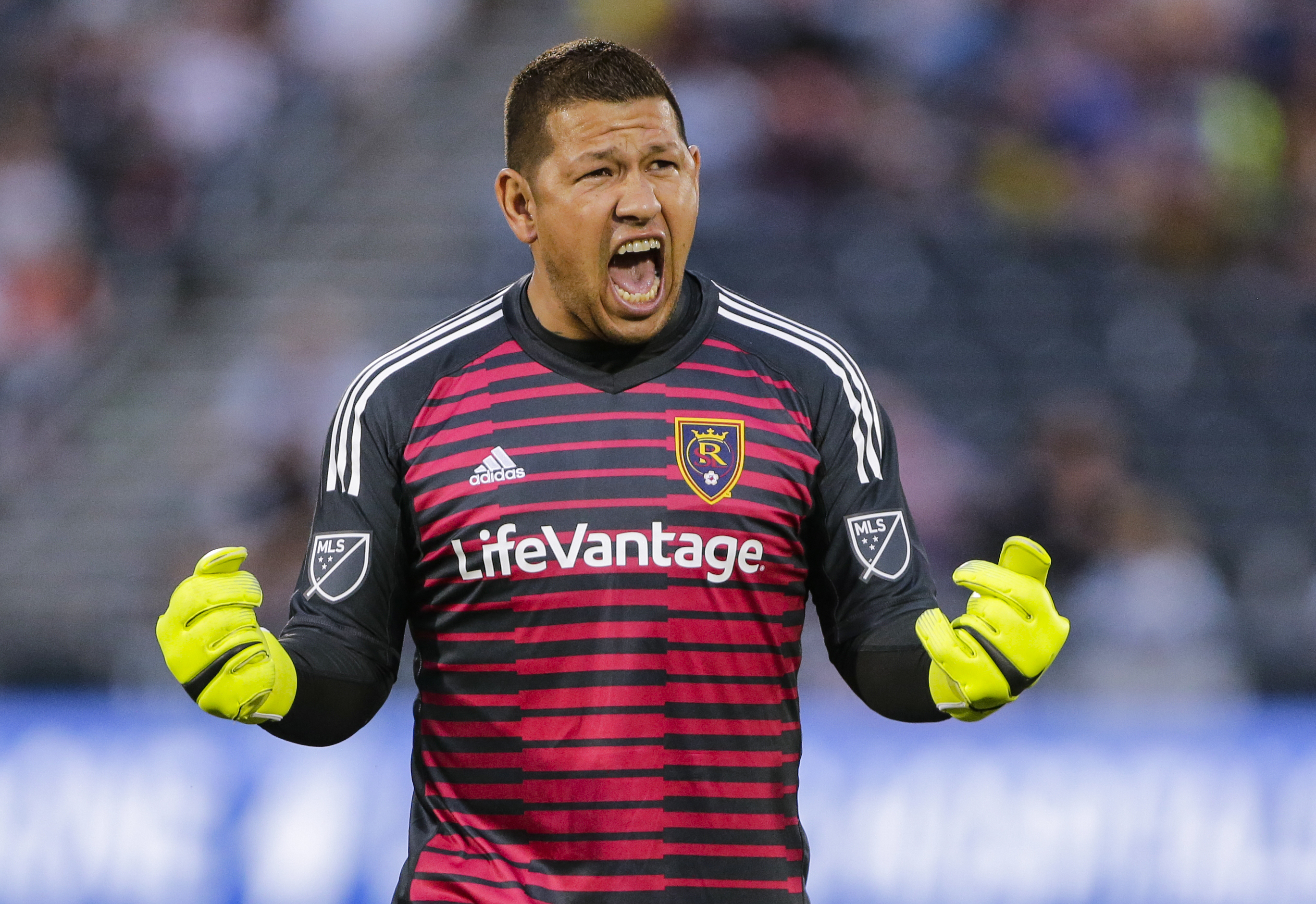 Real Salt Lake goalkeeper Nick Rimando celebrates his team's goal against the Colorado Rapids during the first half of an MLS soccer match, Saturday, Aug. 25, 2018, in Commerce City, Colo. (AP Photo/Jack Dempsey)