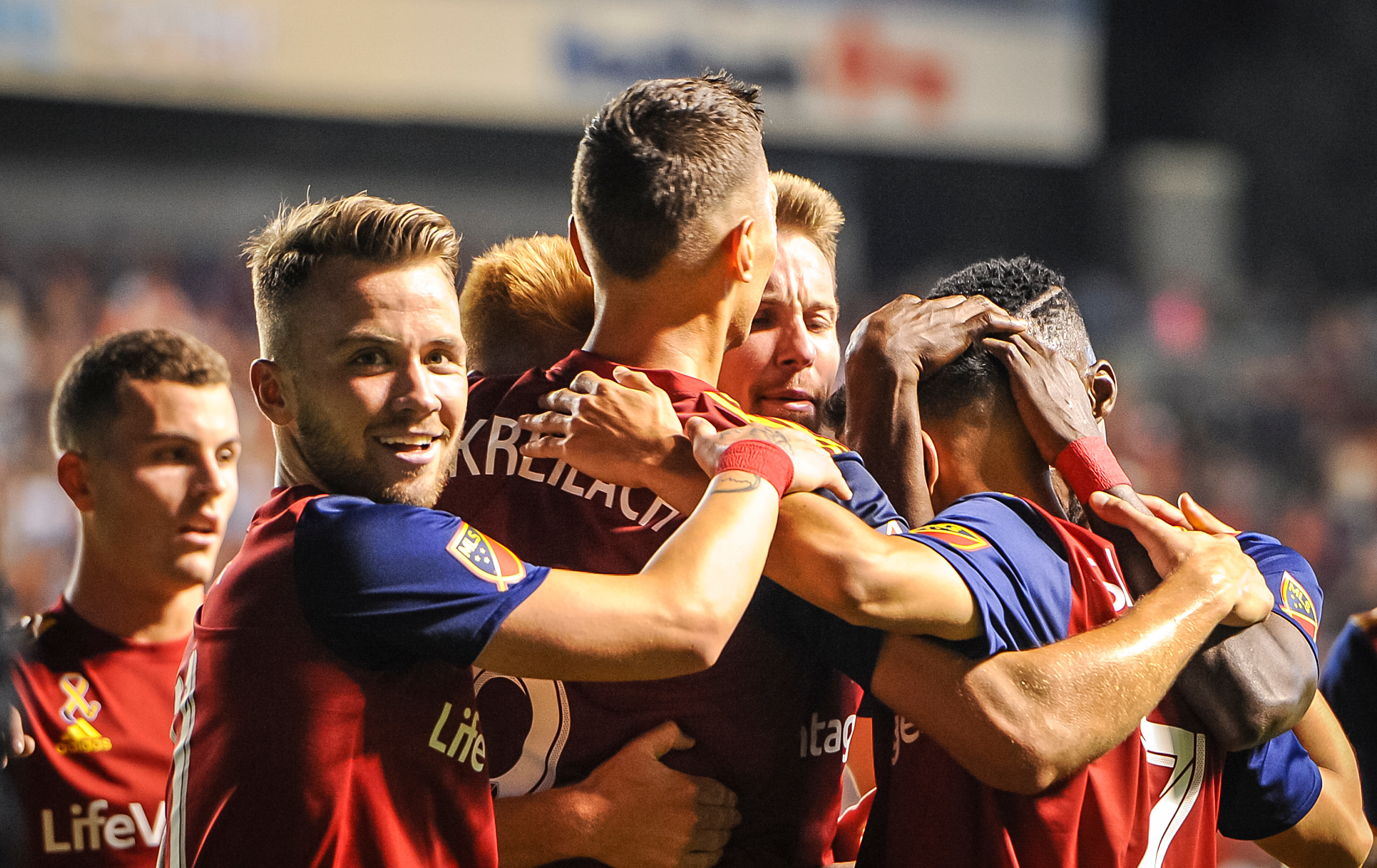 The team rallies around Real Salt Lake forward Jefferson Savarino (7) after he scores one of the 6 goals scored as Real Salt Lake hosts the LA Galaxy at Rio Tinto Stadium in Sandy on Saturday, Sept. 1, 2018.