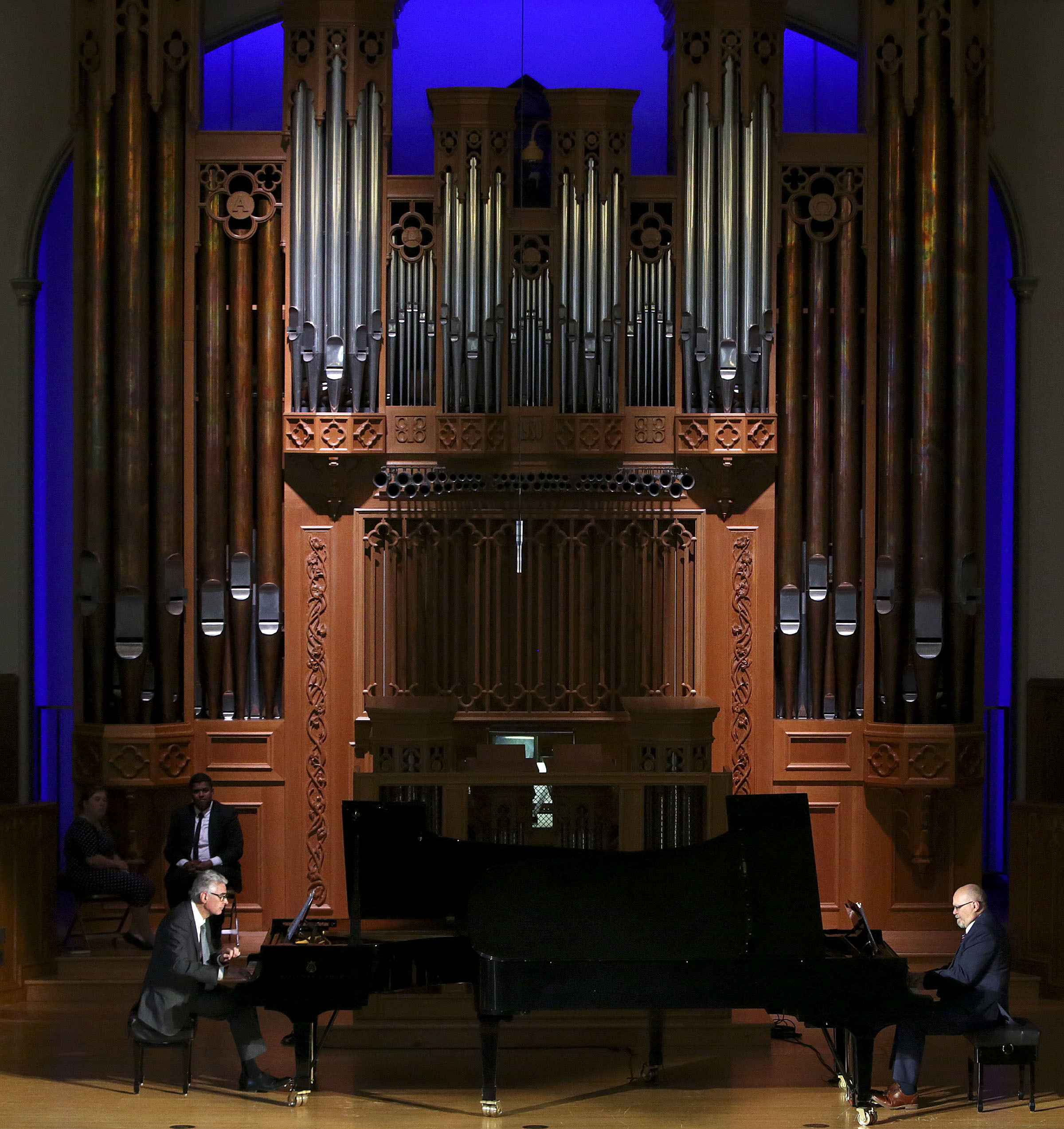 Bishop Gérald Caussé and Nicolas Giusti play a piano duet for LDS Business College students during a devotional at Assembly Hall on Temple Square in Salt Lake City on Tuesday, Sept. 25, 2018. Giusti composed the duet.
