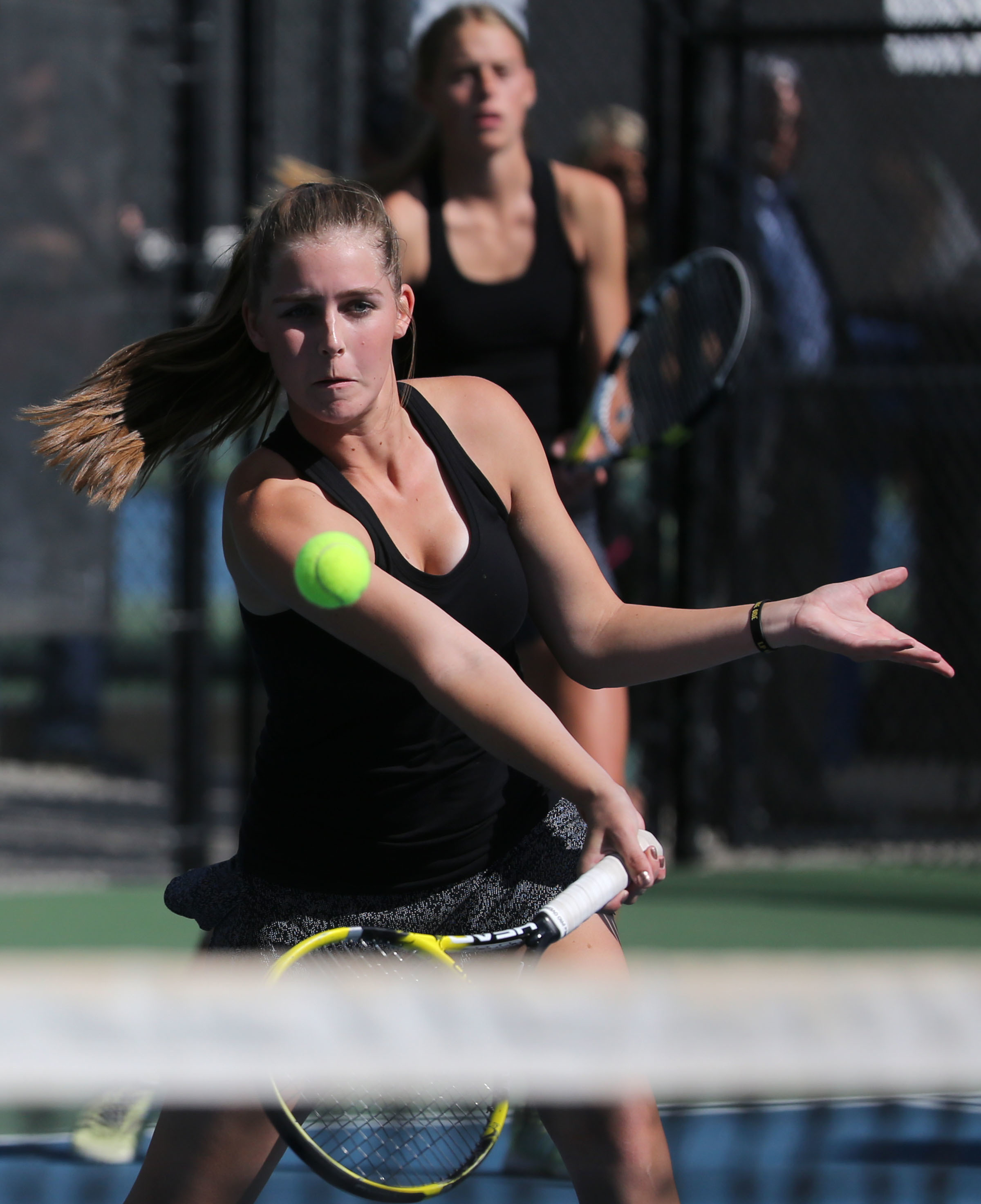 Lone Peak's Katie King competes in and wins the first doubles championship match with Cami Gricius, not pictured, against Davis High during the 6A state tennis tournament at the Liberty Park Tennis Center in Salt Lake City, on Friday, Oct. 6, 2017.