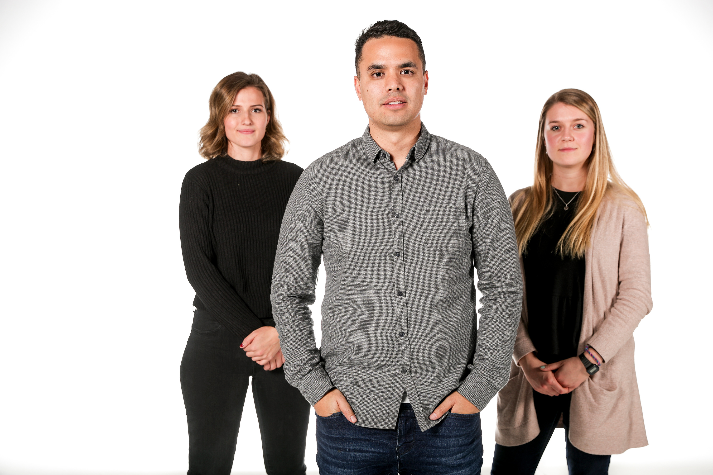 Marissa Folland, 20, Maurice Melligan, 28, and Suzy Thornock, 20, left to right, pose for a photo at the Deseret News in Salt Lake City on Tuesday, Oct. 9, 2018.