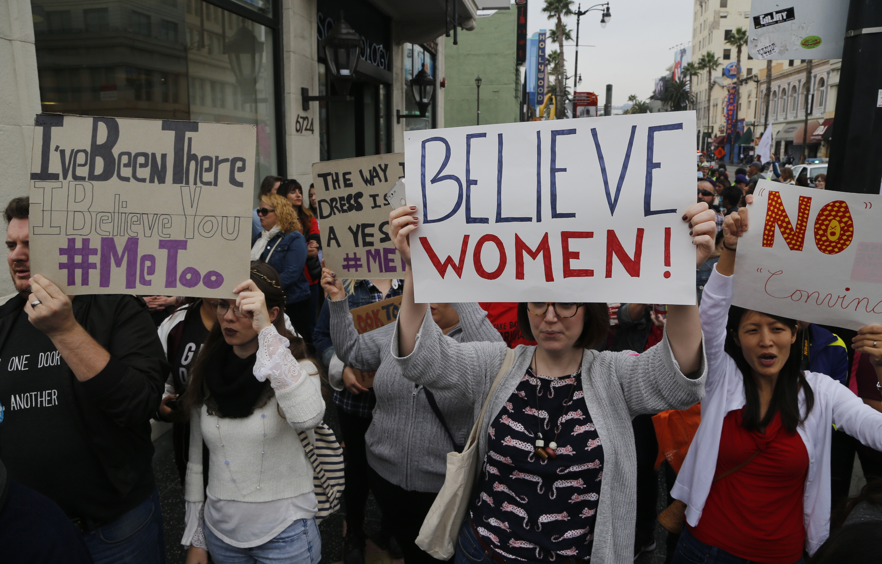 Participants march against sexual assault and harassment at the #MeToo March in the Hollywood section of Los Angeles on Sunday, Nov. 12, 2017.  (AP Photo/Damian Dovarganes)