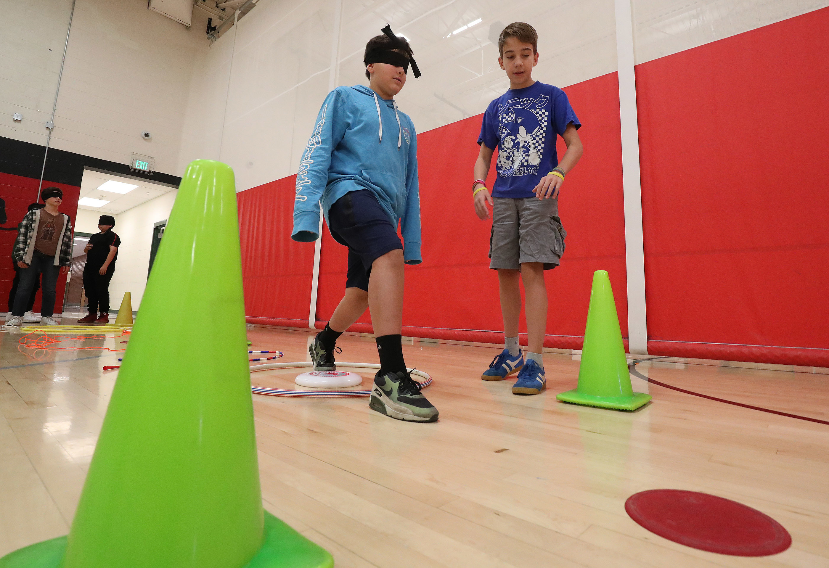 Bryant Middle School students Tobias Barnette and London Christensen participate in a team-building exercise in Salt Lake City on Wednesday, Sept. 19, 2018. The goal was to get to the end of the obstacle course blindfolded without touching any of the fris