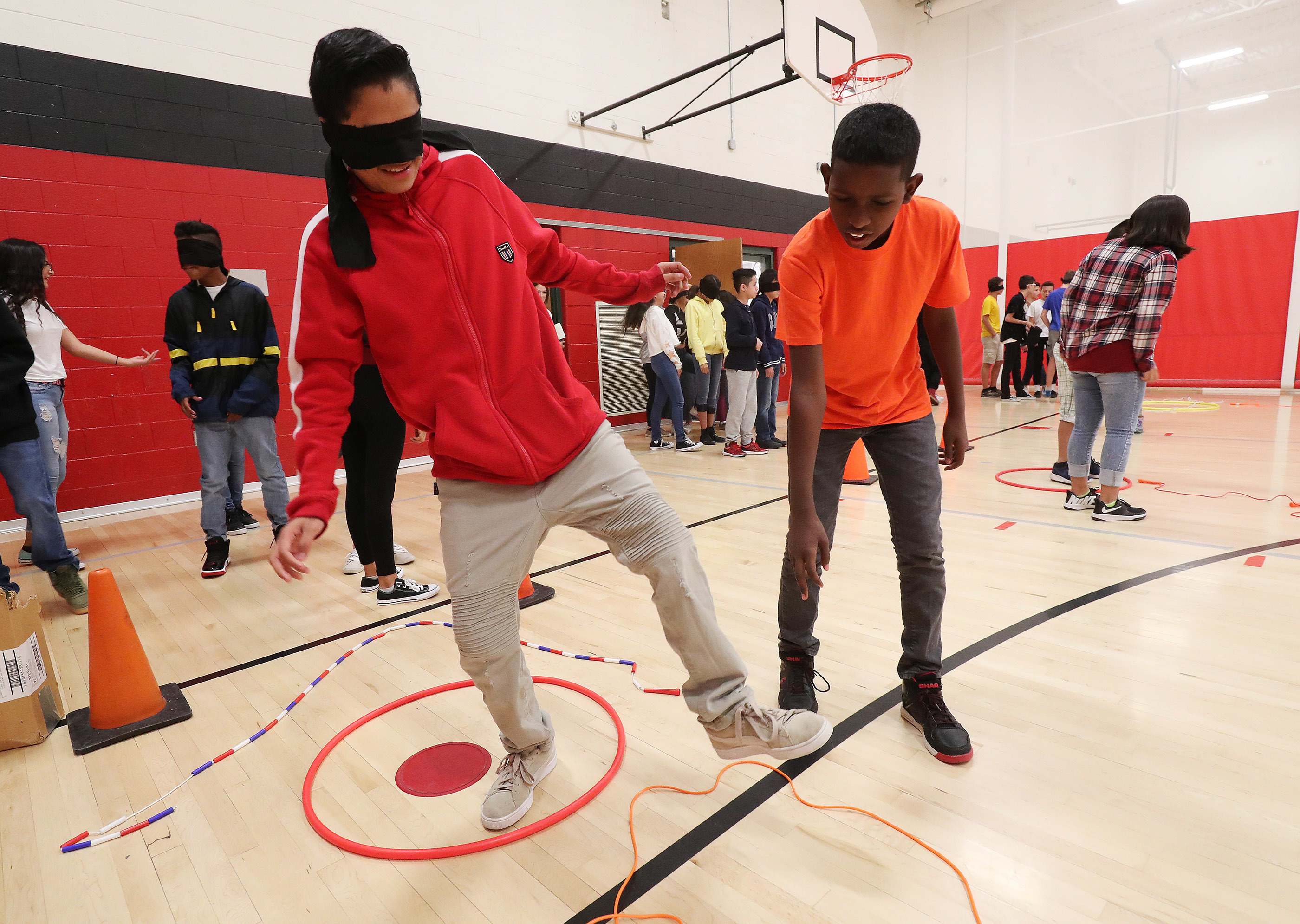 """Bryant Middle School students Andres Hurtado and Arefa Salih participate in a team-building exercise in Salt Lake City on Wednesday, Sept. 19, 2018. """"(My partner) learned when I gave him instructions — he has to listen,"""" Hurtado said.  The social-emotiona"""