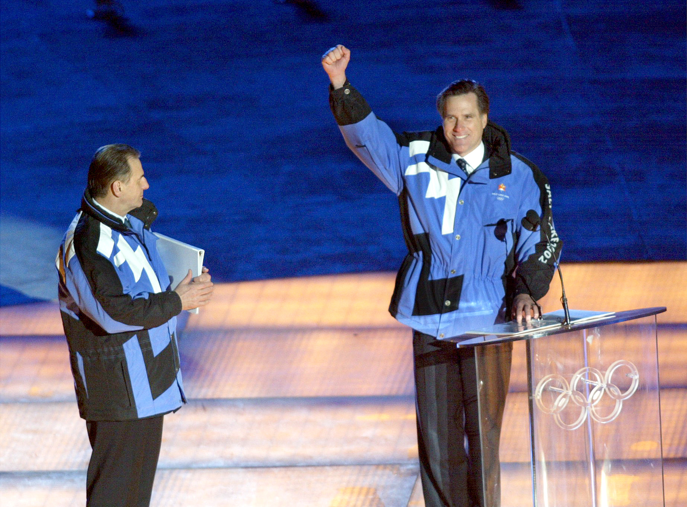 Mitt Romney acknowledges the crowd at the Opening Ceremony of the Salt Lake 2002 Winter Olympic Games at Rice-Eccles Stadium Friday, Feb. 8, 2002.