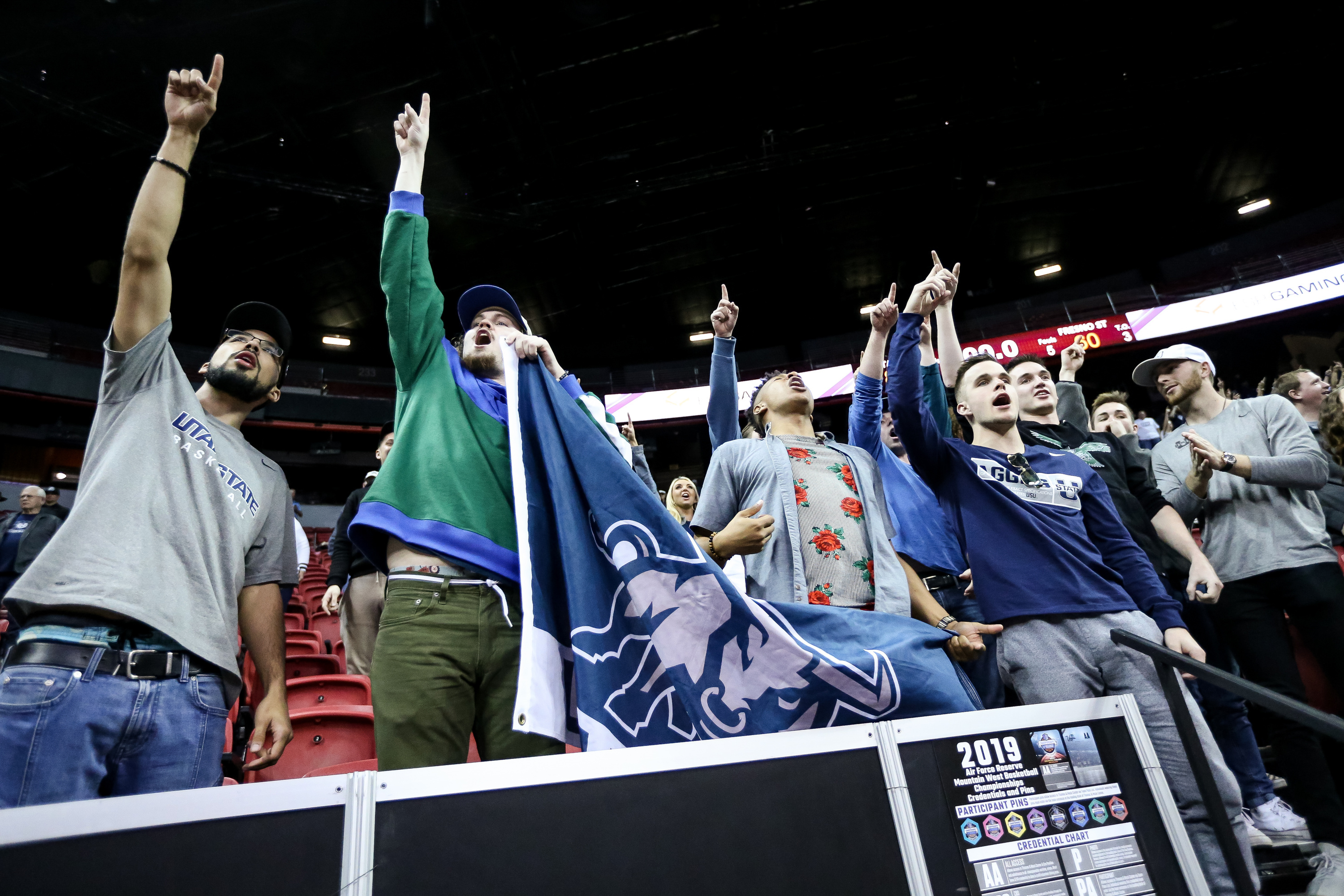 Utah State Aggies fans cheer after their win over the Fresno State Bulldogs in a Mountain West Conference semifinal game at the Thomas & Mack Center in Las Vegas on Friday, March 15, 2019.