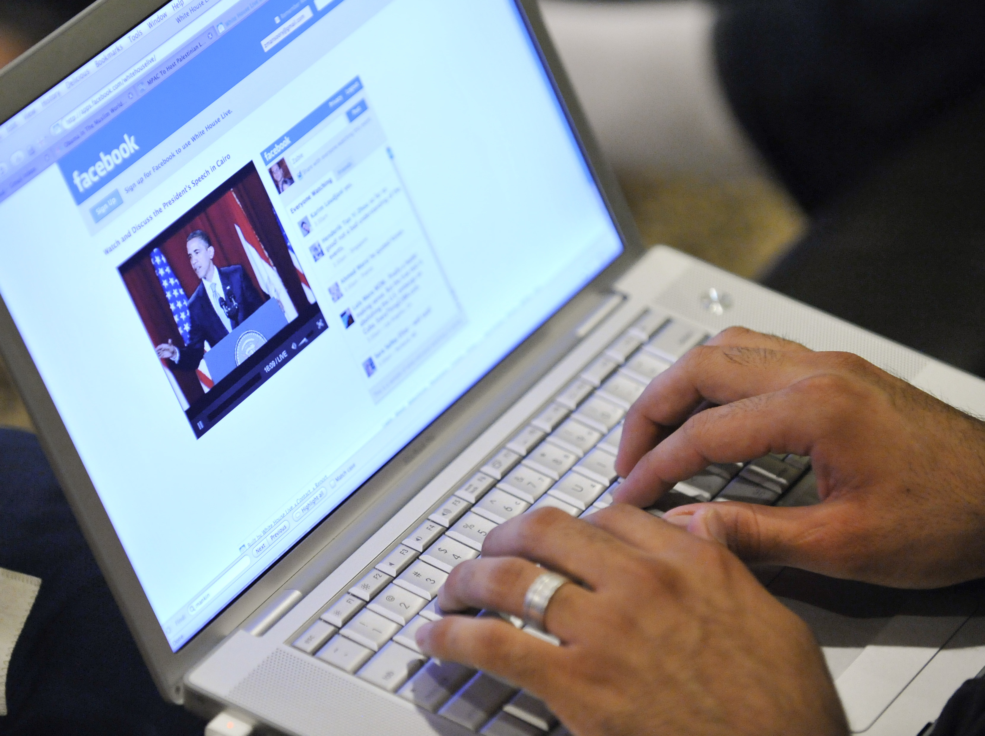 Zabie Mansoory monitors a Facebook discussion board while watching President Barack Obama's televised coverage of President Barack Obama's speech from Cairo University, in the Sylmar area of Los Angeles, early Thursday June 4, 2009.