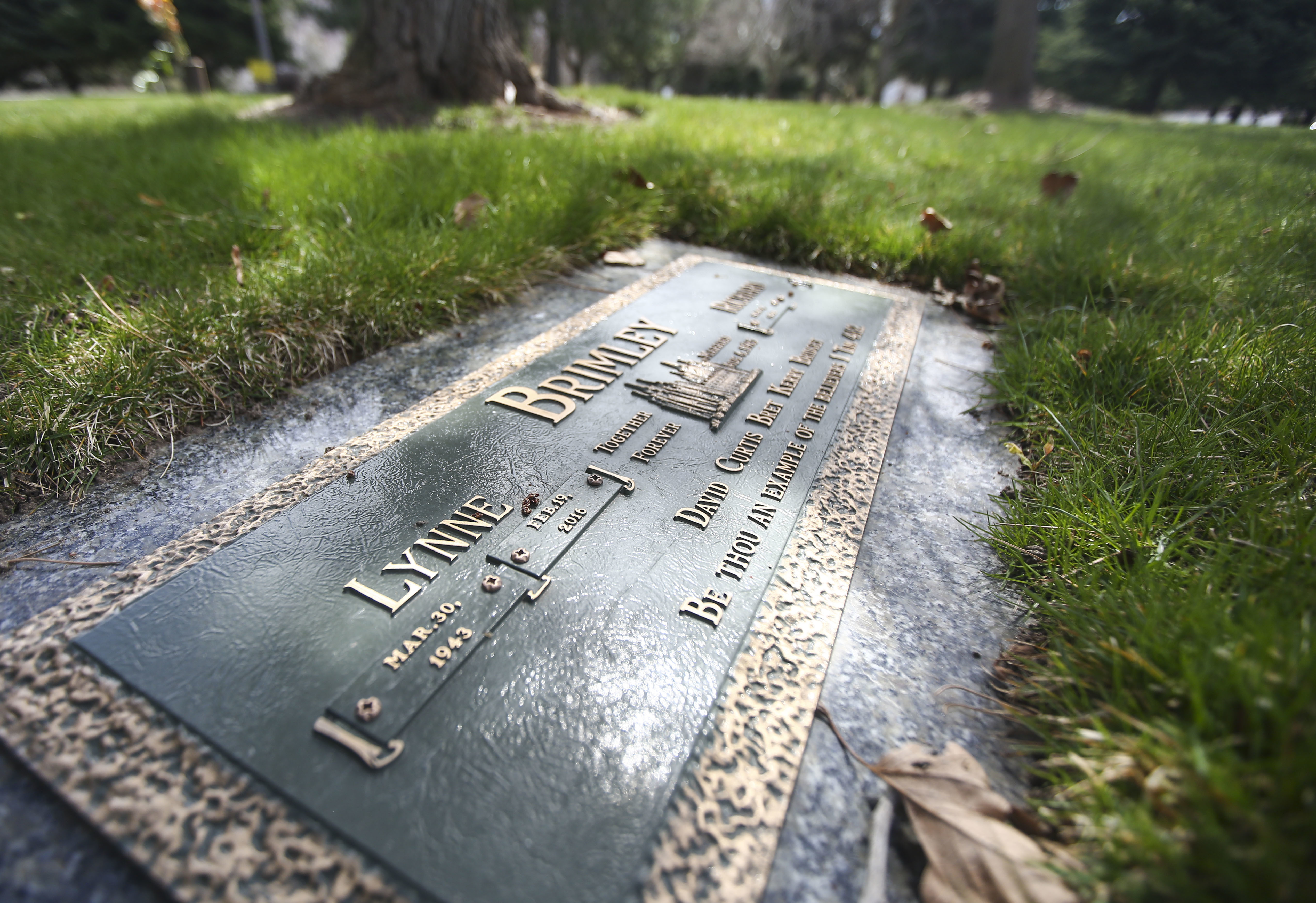 The grave site of Lynne Brimley, a mother of five and grandmother of 20, who went to Portica Body & Face for liposuction in 2016 and 24 hours later was dead, at Mountain View Memorial Estates Cemetery Salt Lake City on Friday, April 5, 2019.