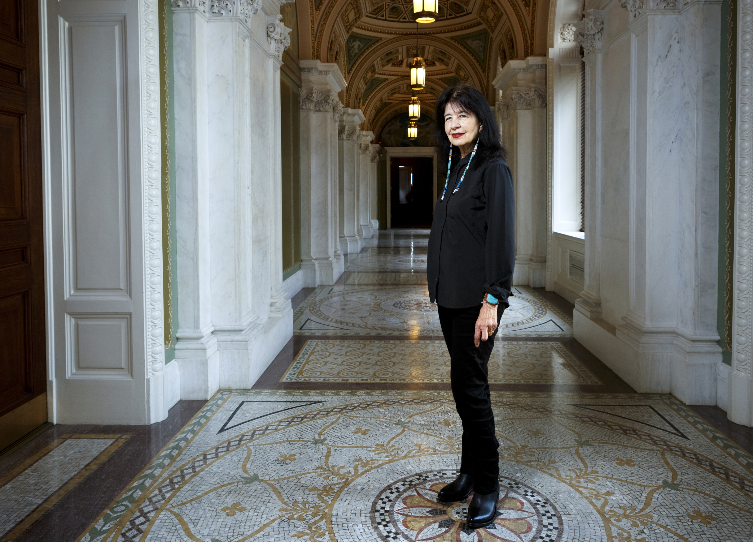 In this June 6, 2019 photo, Joy Harjo, of the United States, poses inside the Library of Congress, in Washington. Harjo has been named the country's next poet laureate, becoming the first Native American to hold that position. Librarian of Congress Carla