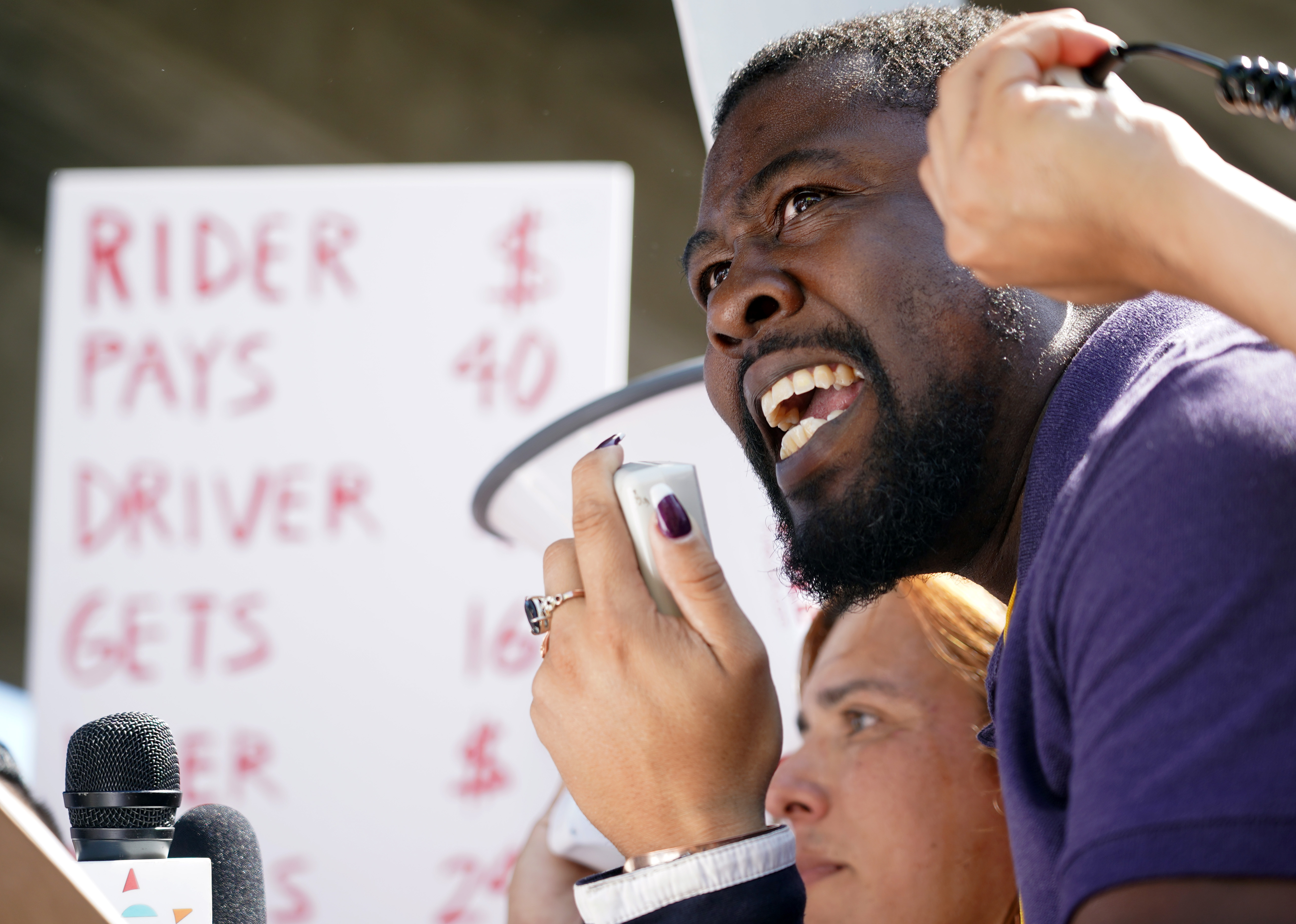 Uber driver James Hicks speaks about his income struggles during a one-day strike against Uber and Lyft in front of an Uber office on Marine Avenue in Redondo Beach on Monday, Mar 25, 2019.