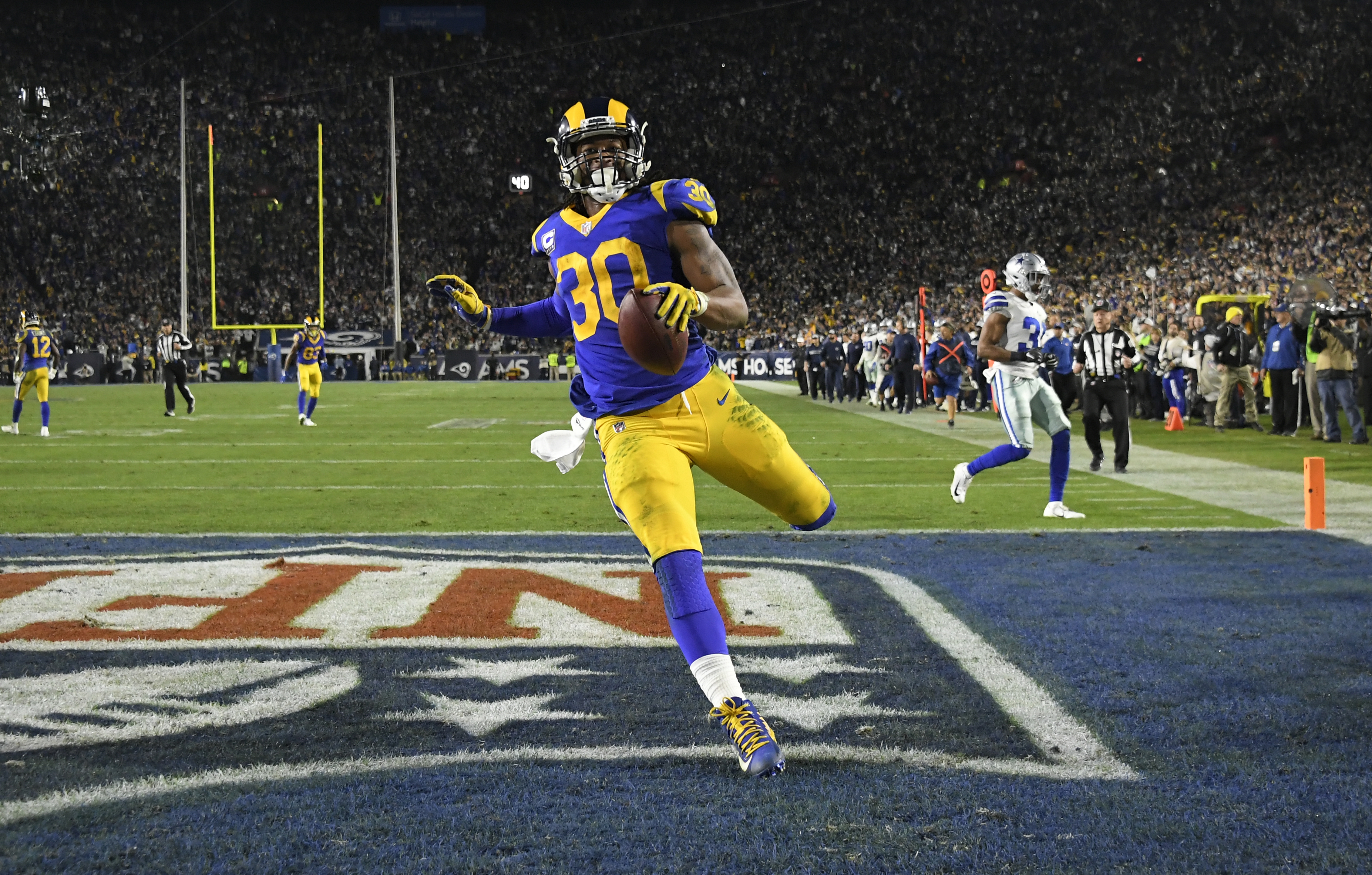 Los Angeles Rams RB Todd Gurley scores a touchdown against the Dallas Cowboys in the Divisional Round of the 2019 NFL Playoffs, Jan. 12, 2019.