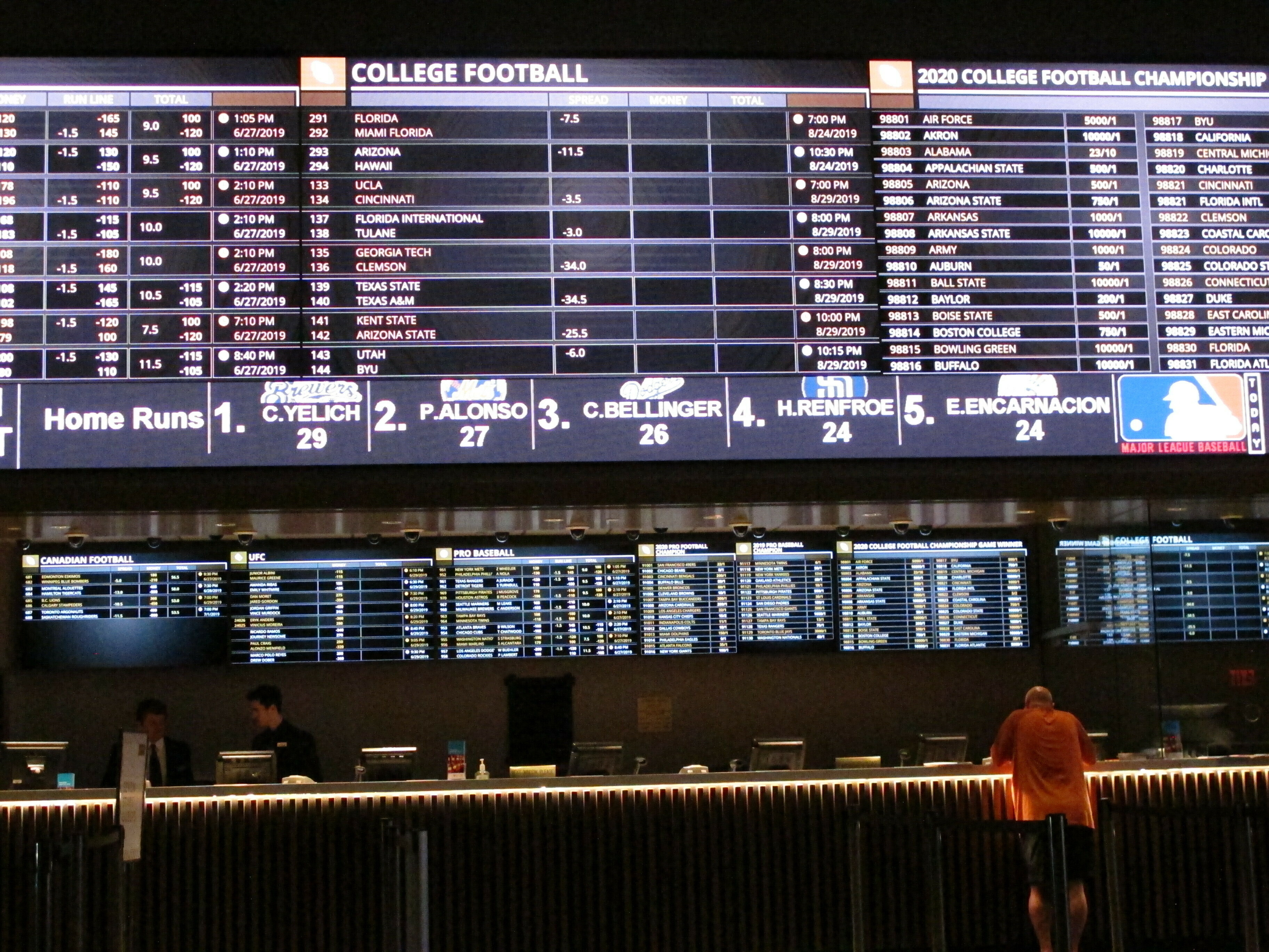 A gambler places a bet last month at a New Jersey sports book. Such wagering could roll out in Illinois by early next year, lawmakers say.