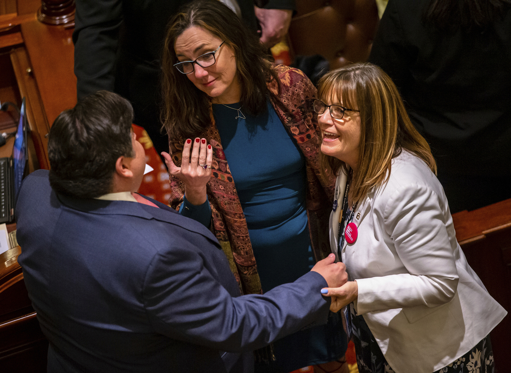 State Rep. Kelly Cassidy (center) talks with Gov. J.B. Pritzker and state Sen. Melinda Bush as they celebrate Senate passage of the Reproductive Health Act, at the State Capitol in May.