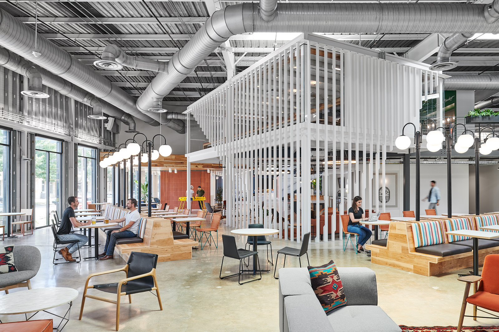 Photo of an industrial-contemporary office with modern furniture and open space