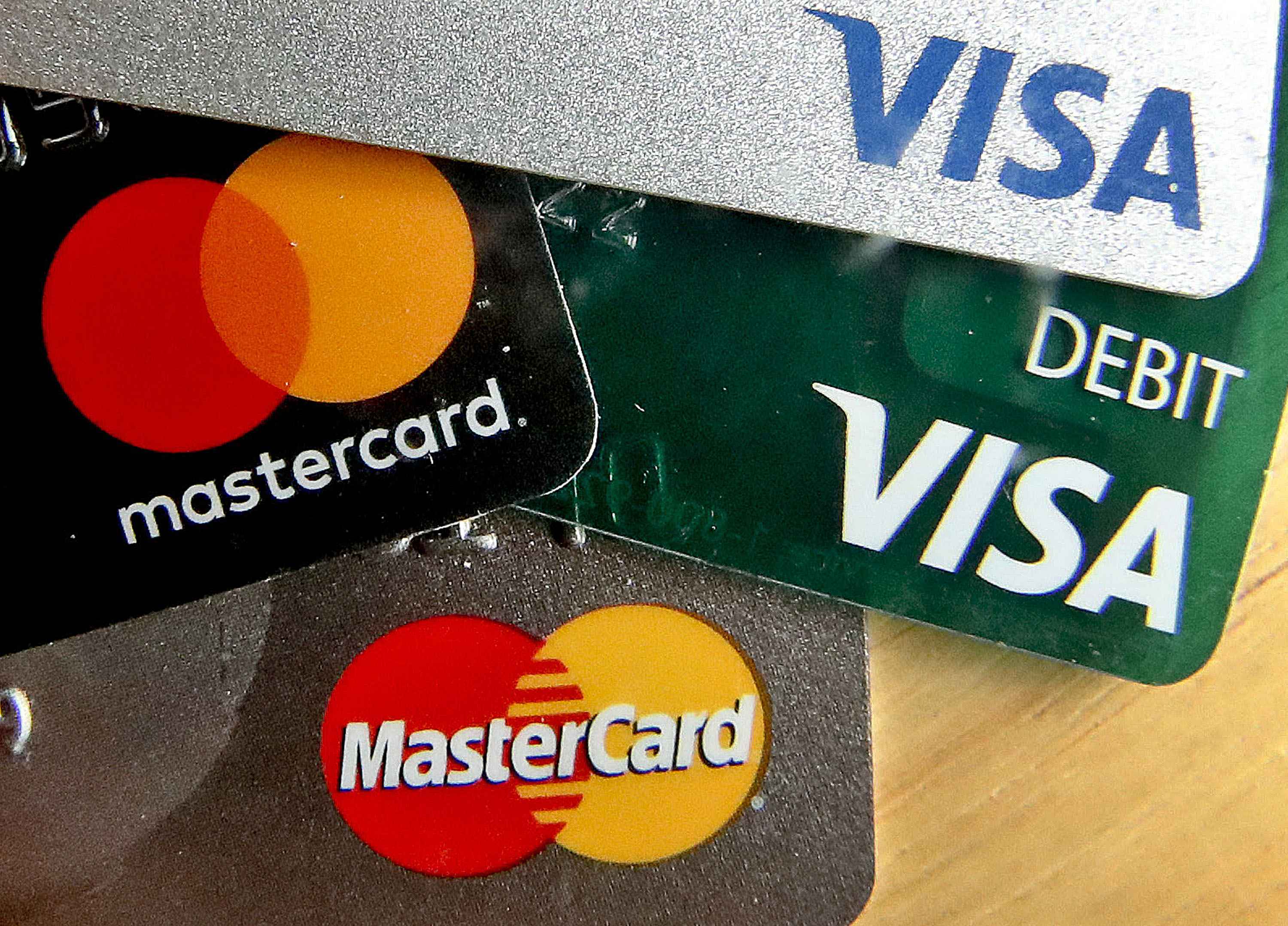 """Consumers should bring more than one card on trips and vary which ones they use to minimize """"holds"""" piling up."""