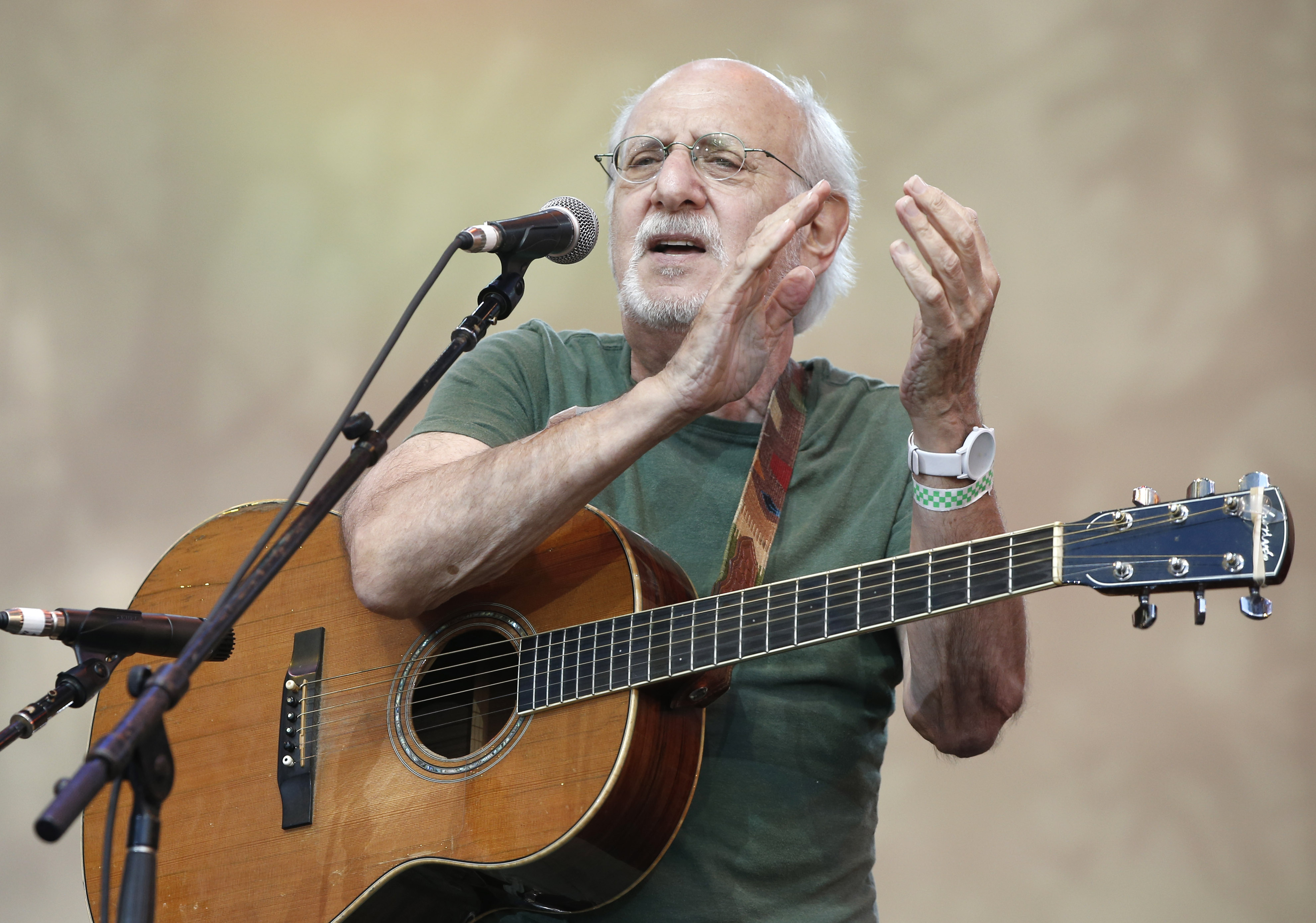 """In this July 20, 2014, file photo, singer-songwriter Peter Yarrow, of the 1960's era musical trio """"Peter Paul and Mary,"""" claps and encourages the audience to sing along during a memorial tribute concert for folk icon and civil rights activist Pete Seeger"""
